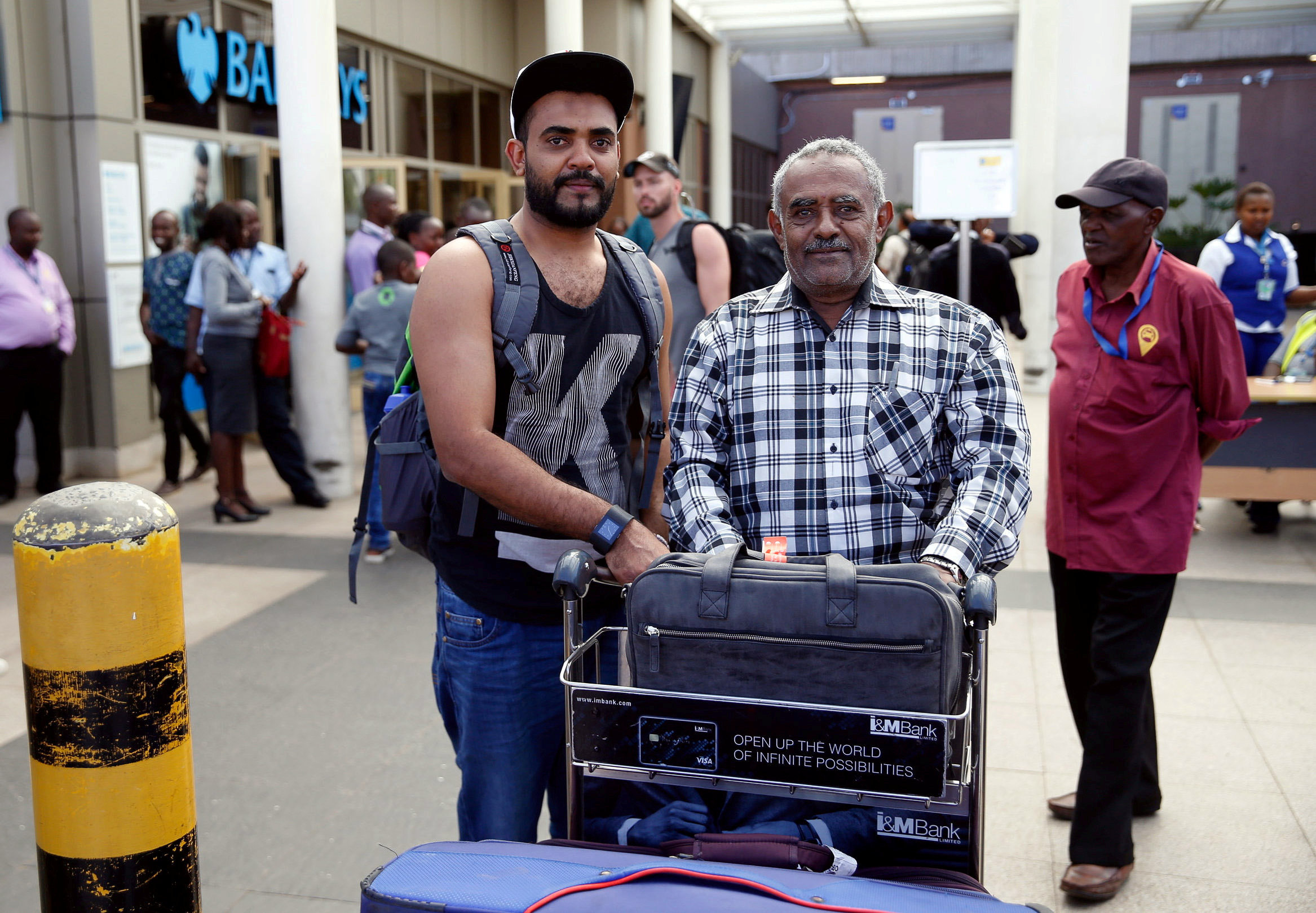 Ahmed Khalid, left, says he was supposed to travel to Nairobi on the Ethiopian Airlines Flight 302 that crashed but missed the flight because of a delay. His father Khalid Bzambur, right, picked him up at Jomo Kenyatta International Airport in Nairobi on March 10.