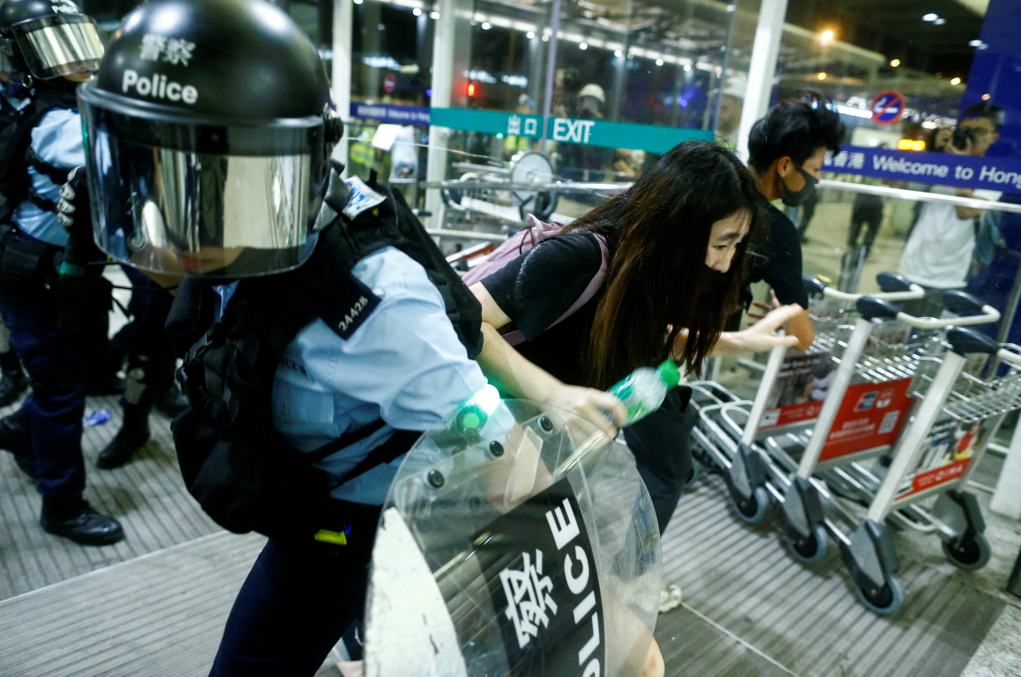 Hong Kong protests: riot police clash with protesters at