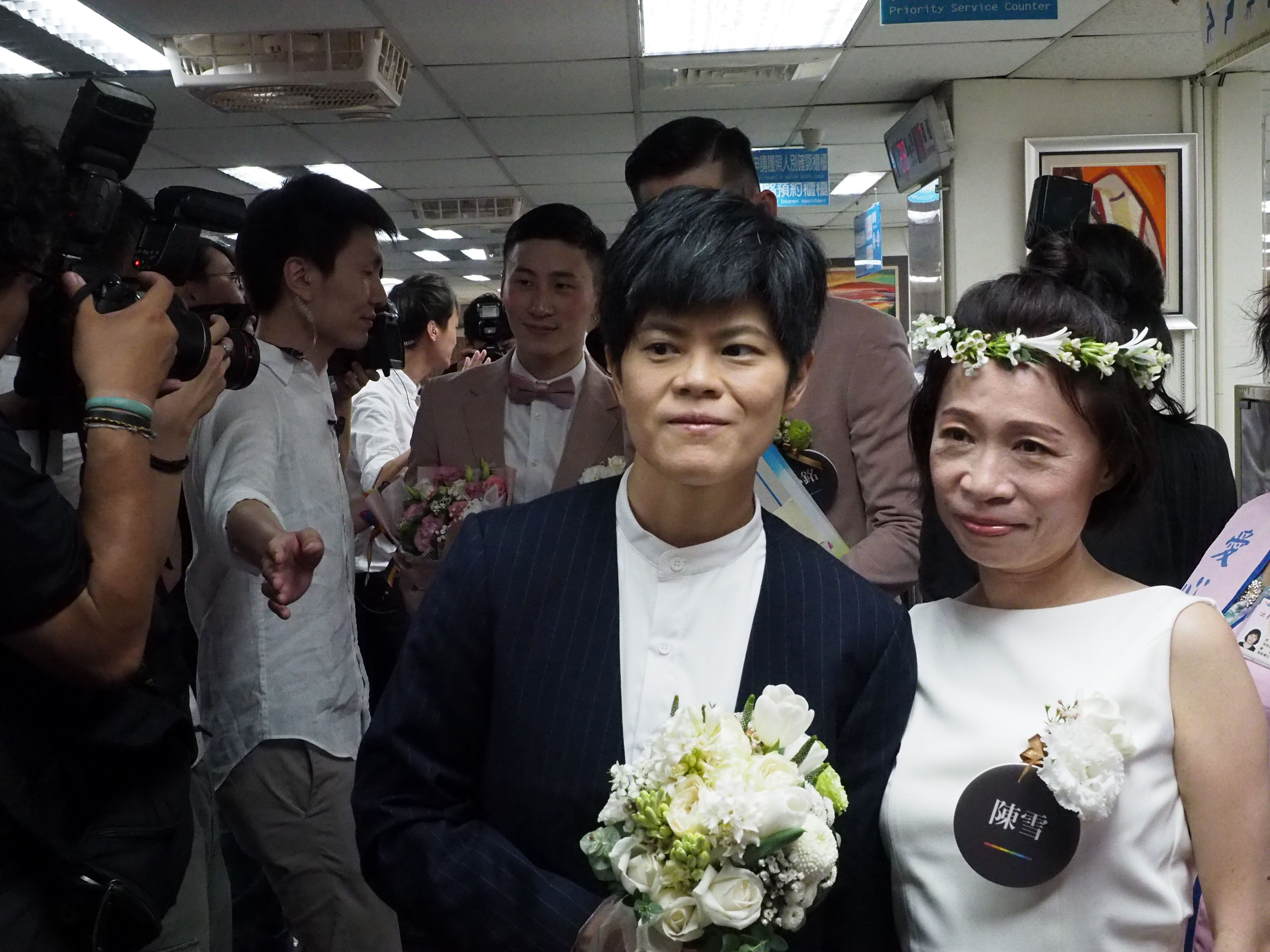 Taiwanese writer Chen Hsueh, right, and her partner, center, pose for a photo.