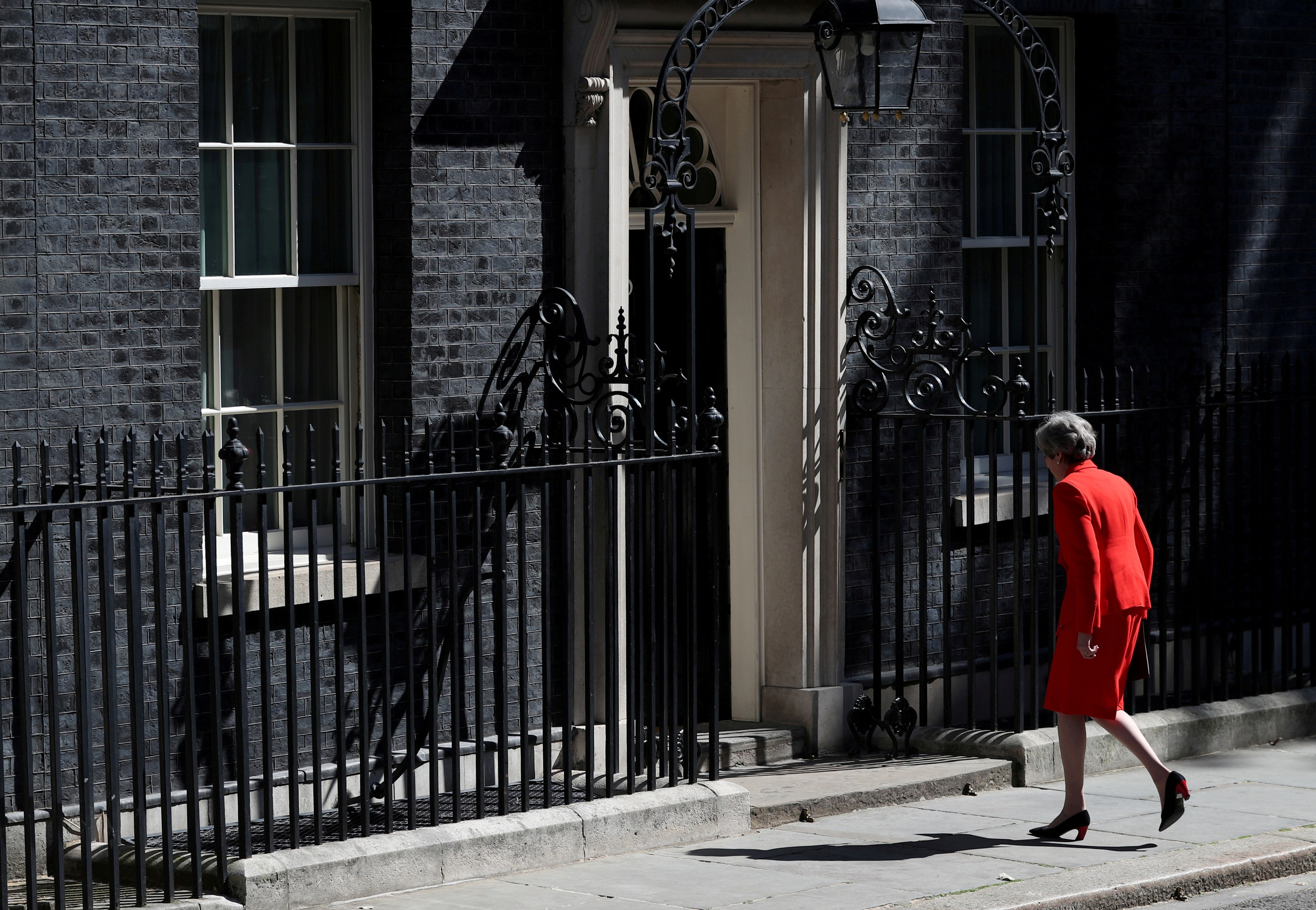 British Prime Minister Theresa May leaves after making a statement at Downing Street in London.