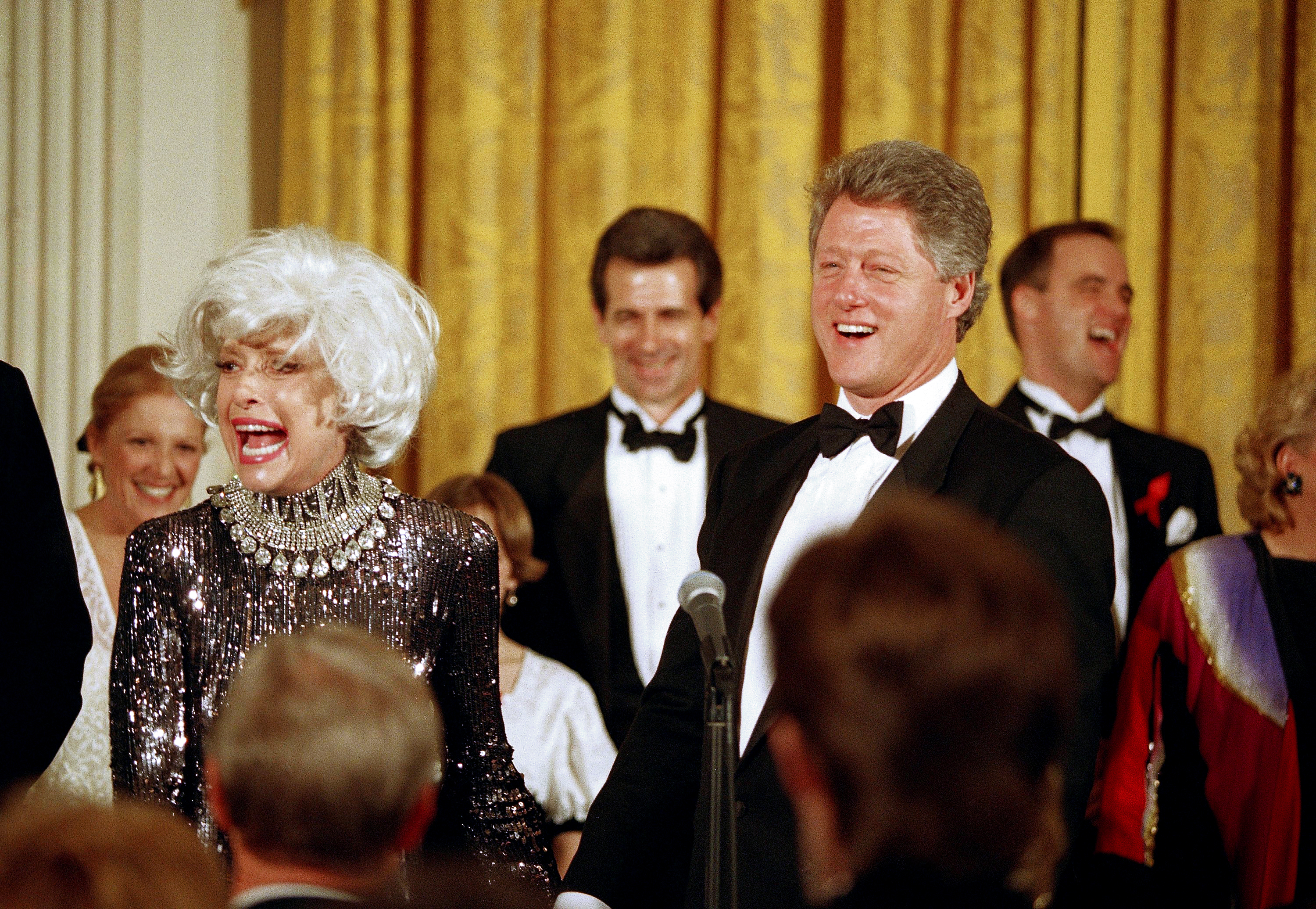 President Bill Clinton greets Carol Channing after she and several others provided entertainment at a White House dinner for the National Governors Association, Feb. 1, 1993 in Washington. (Wilfredo Lee/AP)