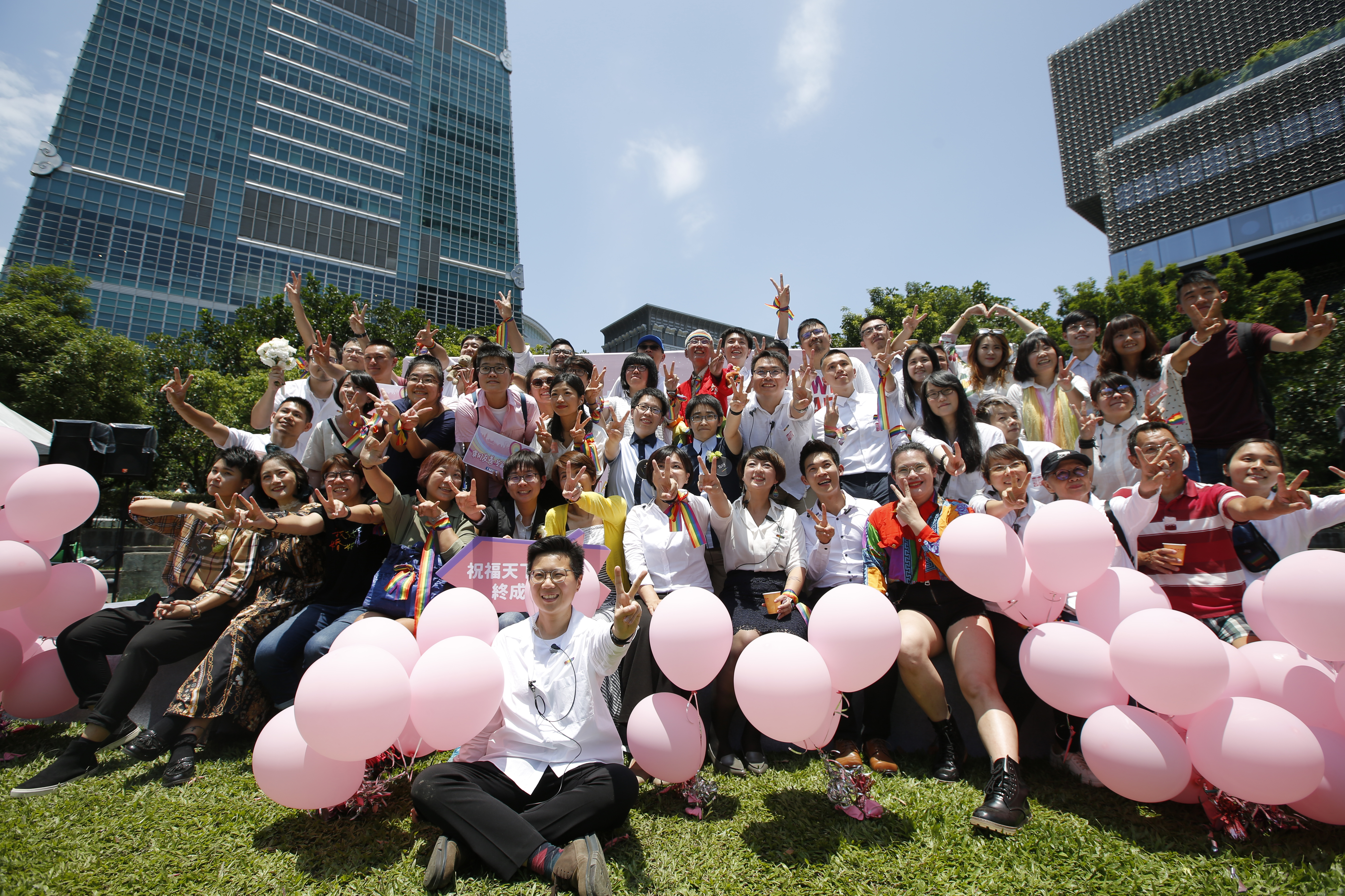 Attendees pose for photographs during a pro-same-sex marriage party organized by the Taipei City government and Marriage Equality Coalition Taiwan in Taipei on Friday. (Ashley Pon/Bloomberg News)
