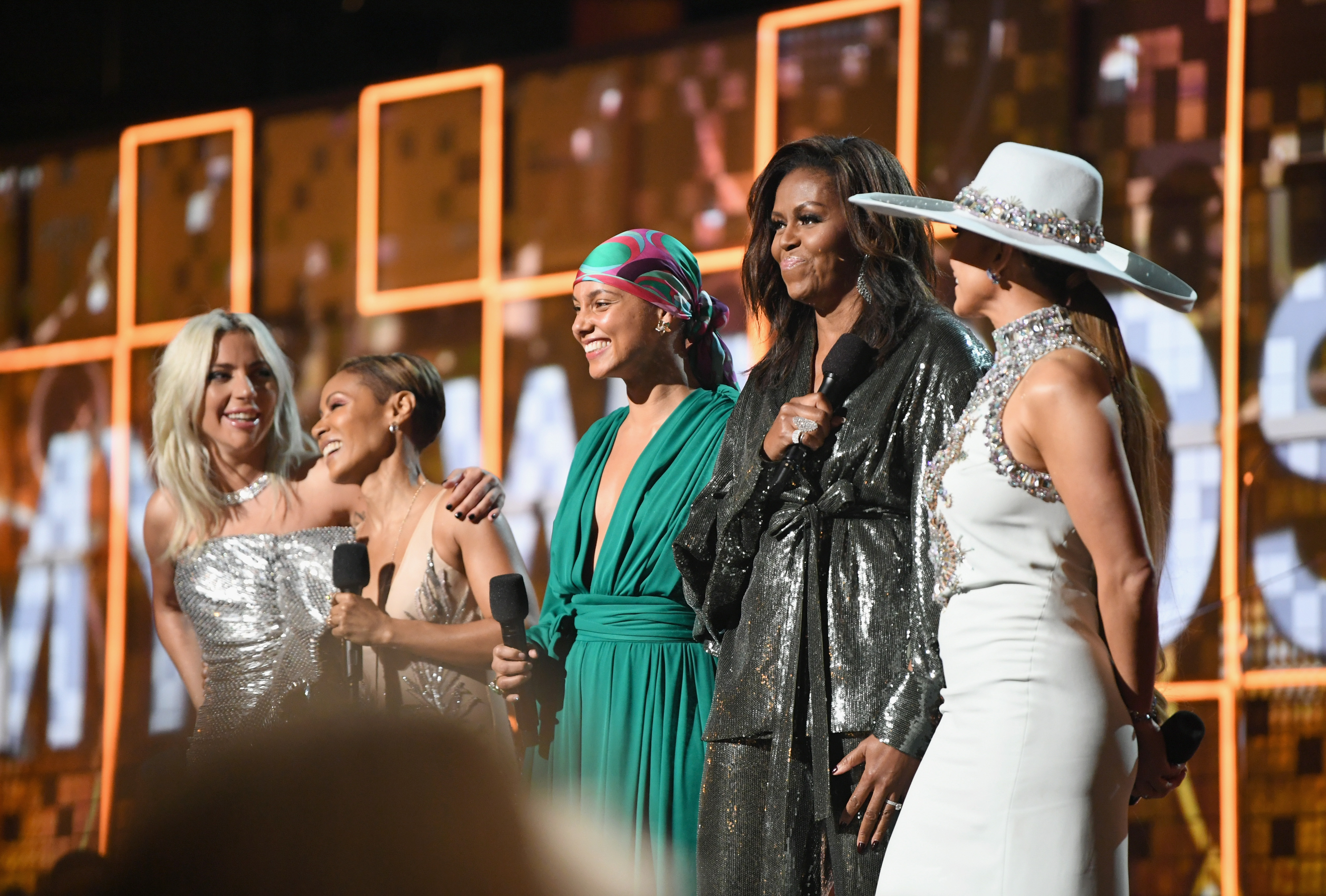 Lady Gaga, Jada Pinkett Smith, Alicia Keys, Michelle Obama and Jennifer Lopez speak onstage at the Grammys. (Emma McIntyre/Getty Images for The Recording Academy)