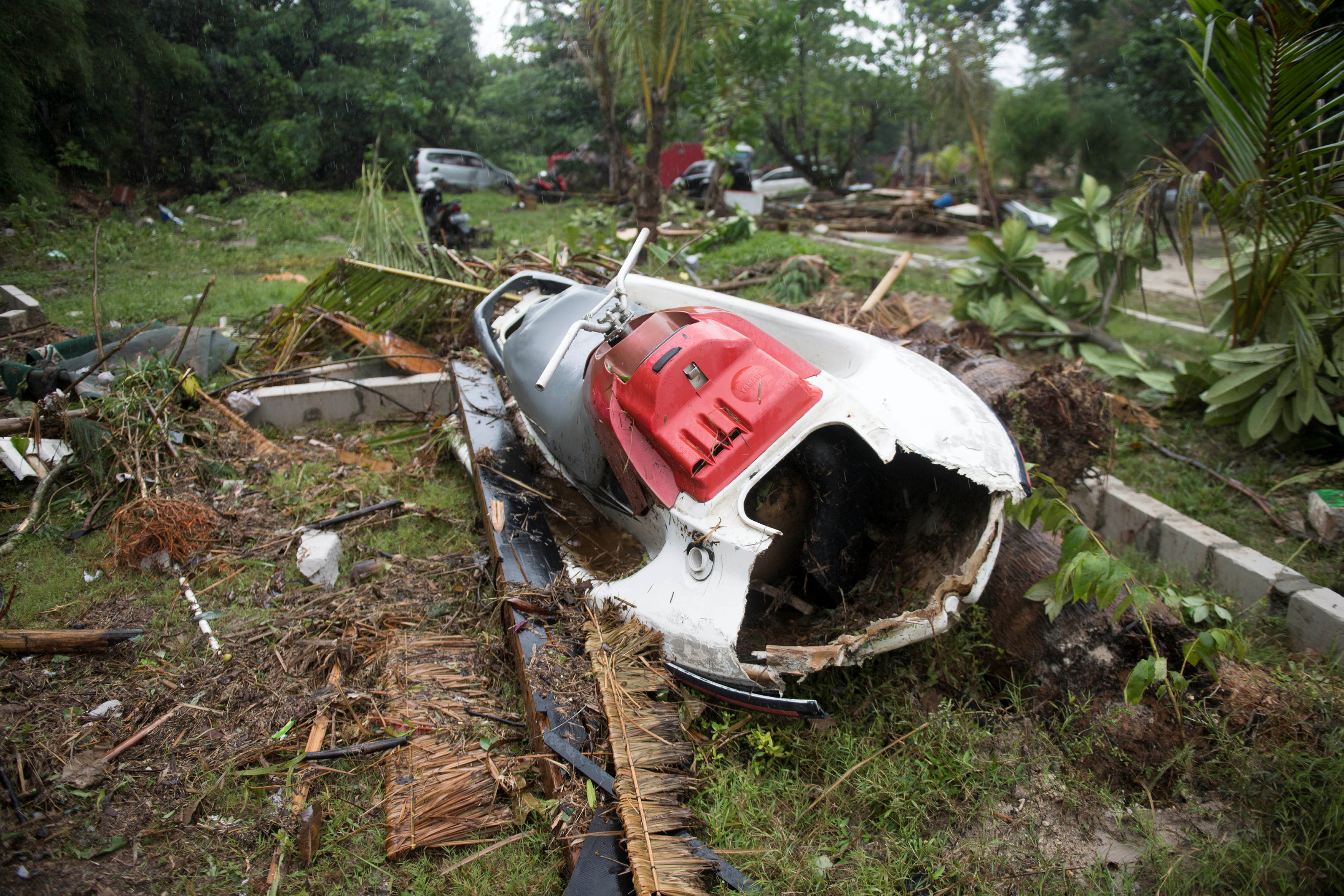Tsunami death toll rises as rescue efforts expand along the