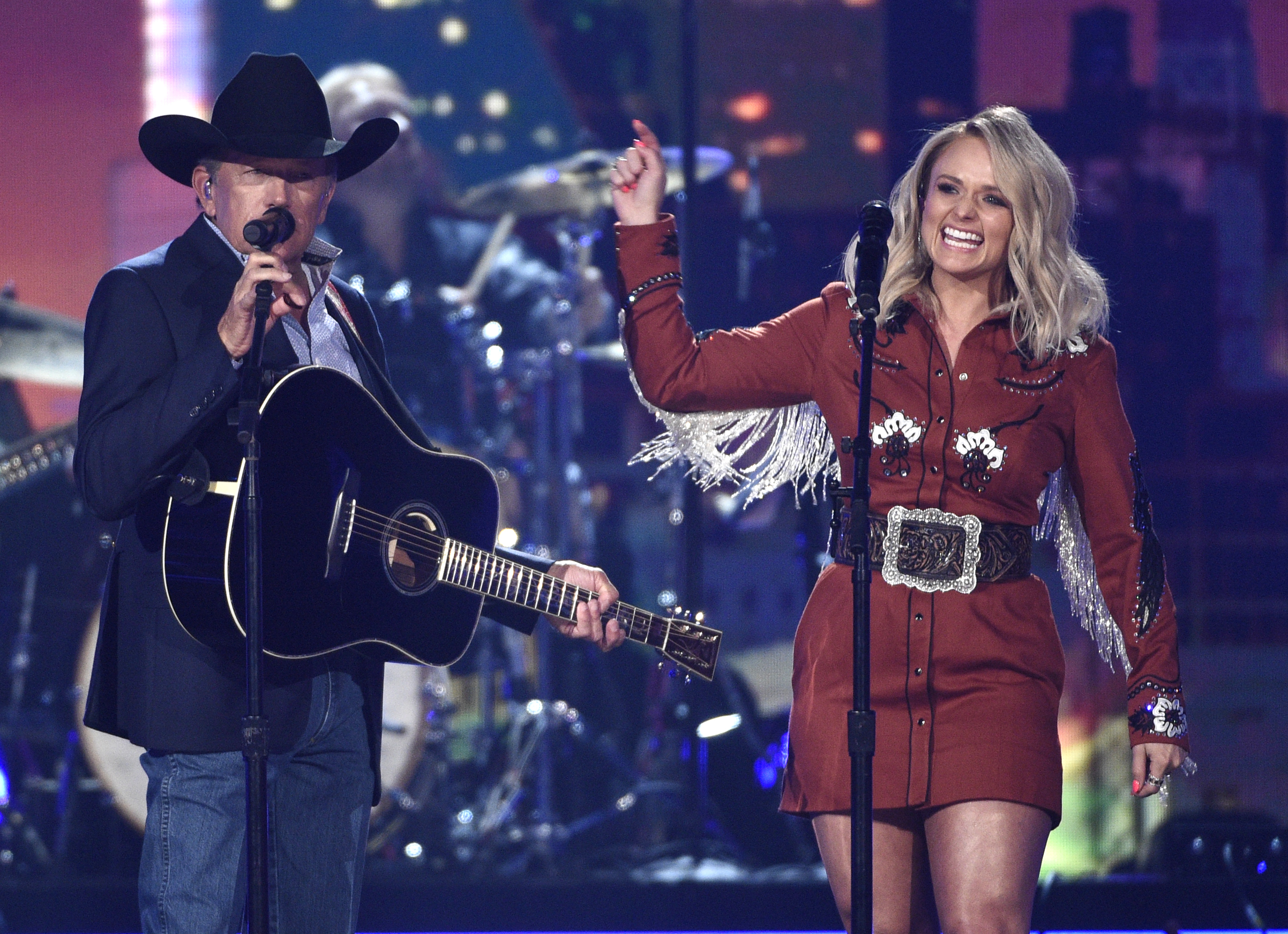 "George Strait and Miranda Lambert perform ""Run."" (Chris Pizzello/Invision/AP)"