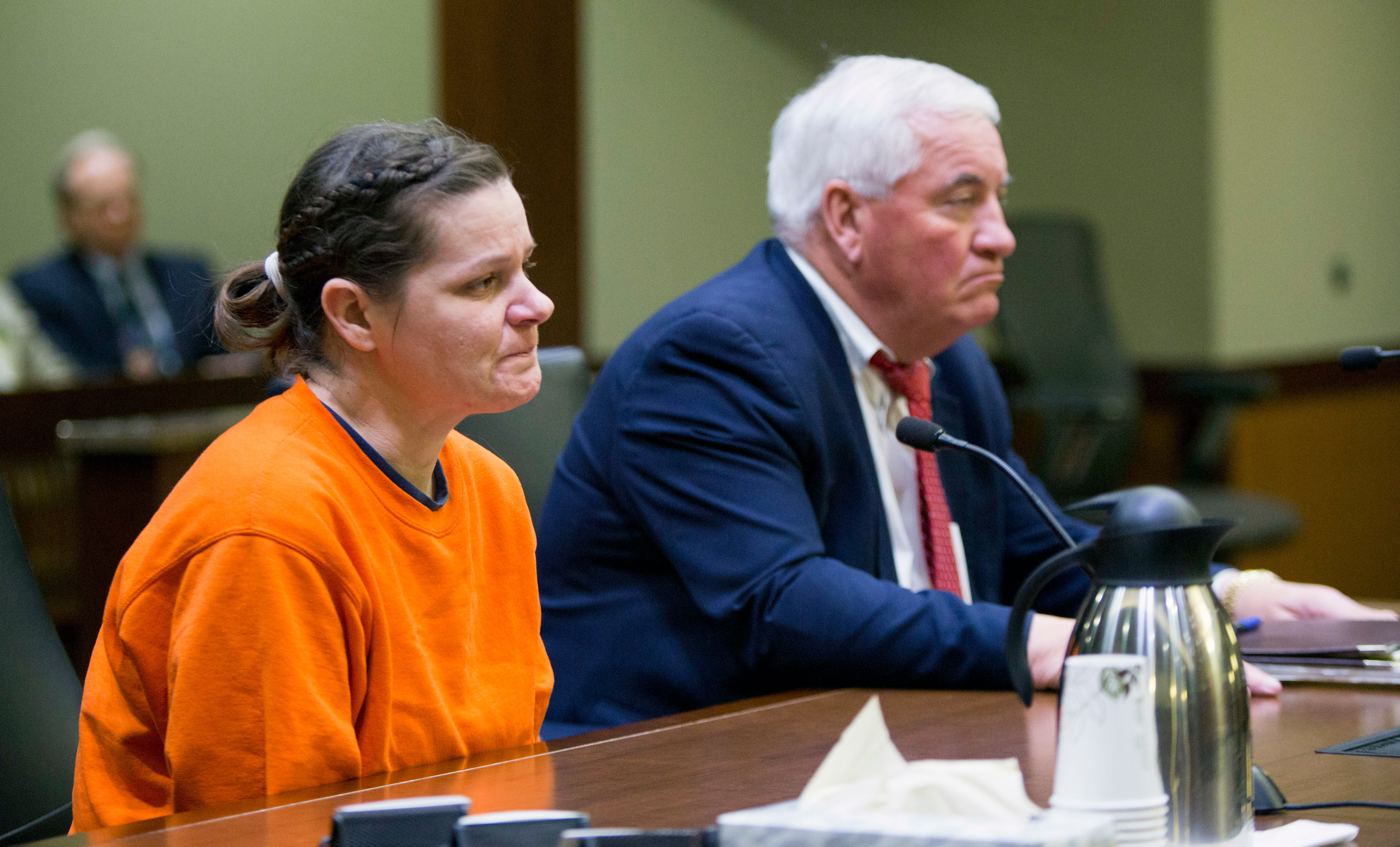 Woman pleads guilty to murdering pregnant neighbor