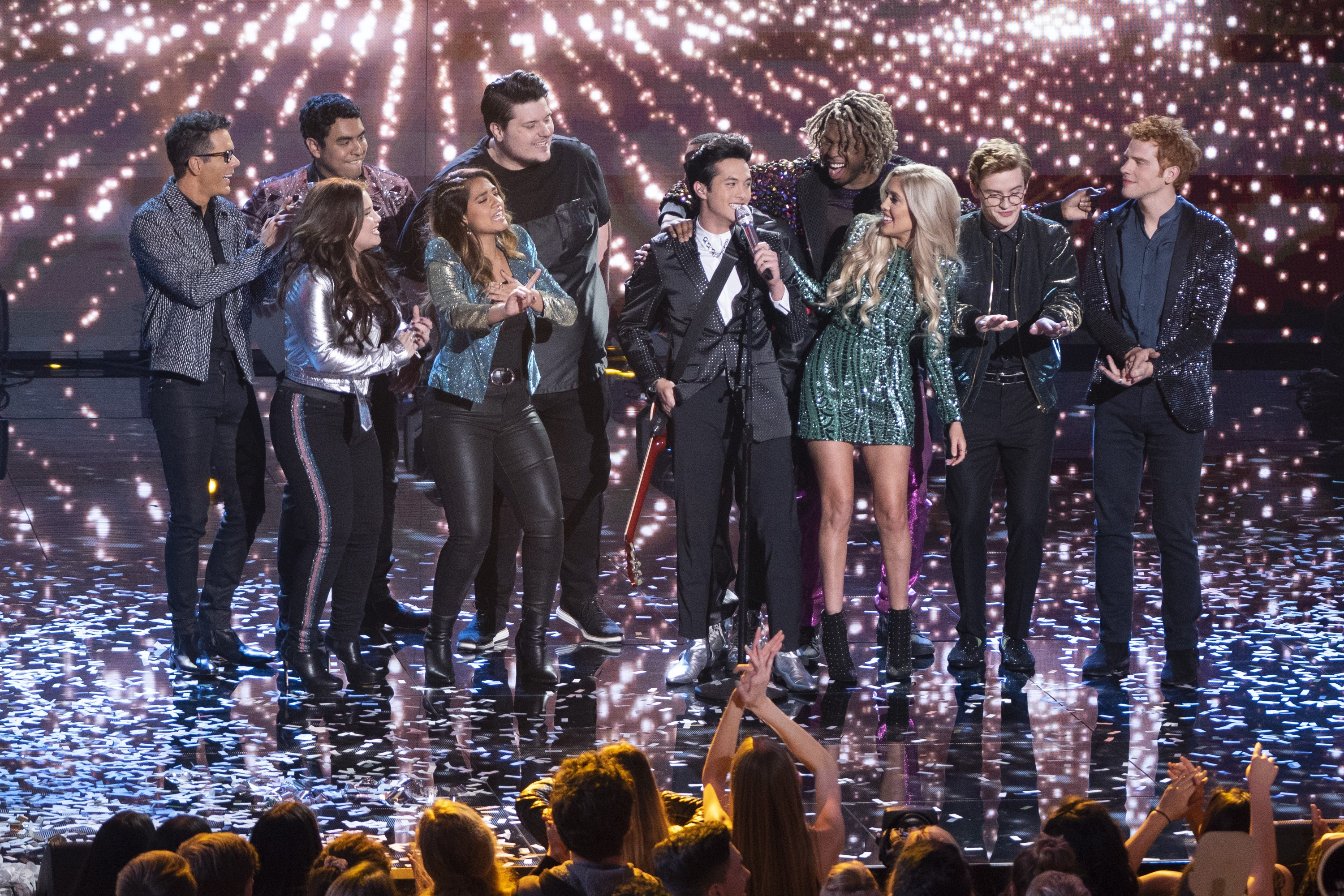 """American Idol"" Season 17 winner Laine Hardy sings his coronation song, ""Flame,"" surrounded by his fellow contestants and mentor Bobby Bones."