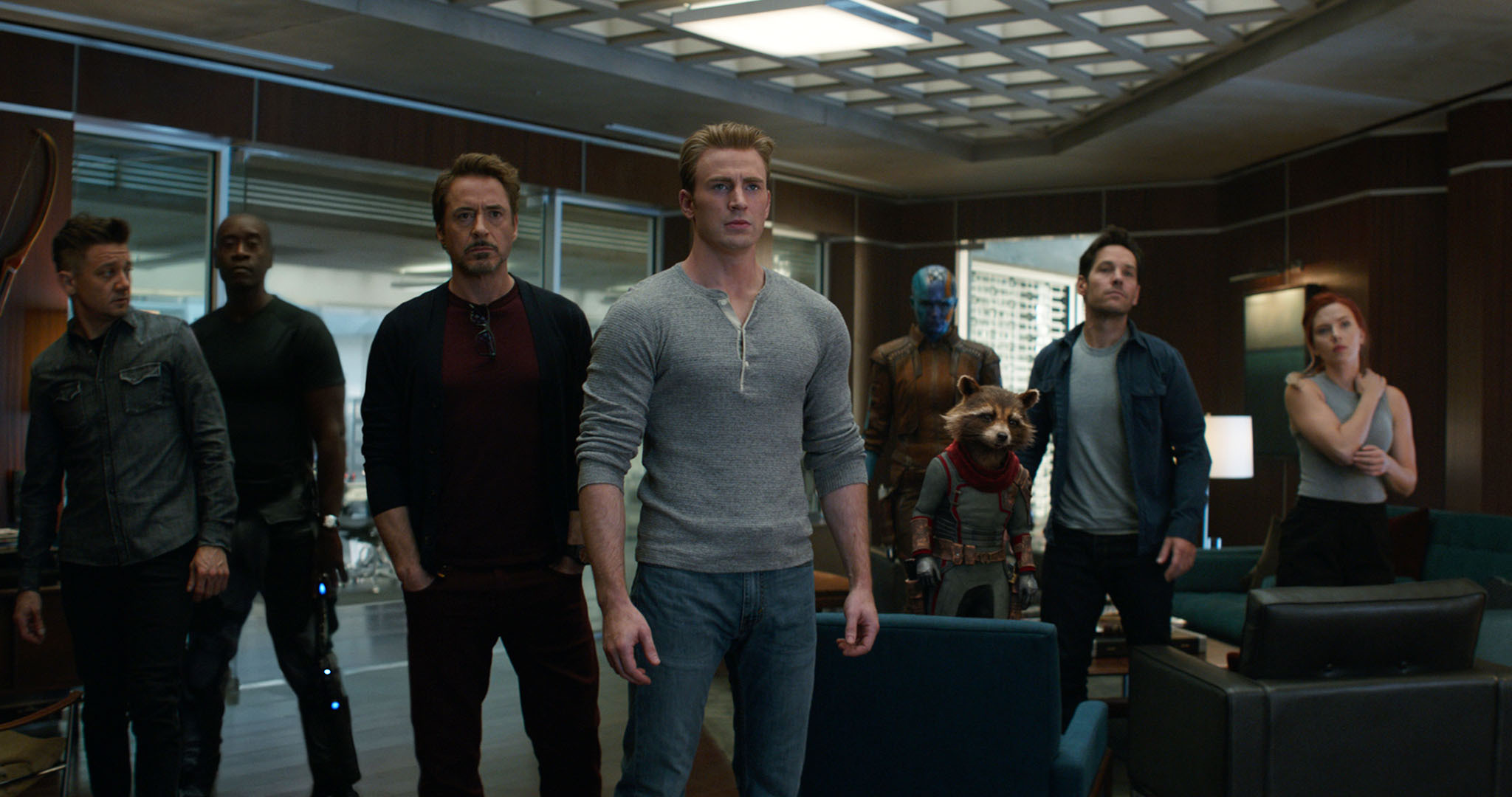 "The cast members of ""Avengers: Endgame,"" from left: Jeremy Renner, Don Cheadle, Robert Downey Jr., Chris Evans, Karen Gillan, the character Rocket, voiced by Bradley Cooper, Paul Rudd and Scarlett Johansson. (Disney/Marvel Studios via AP)"