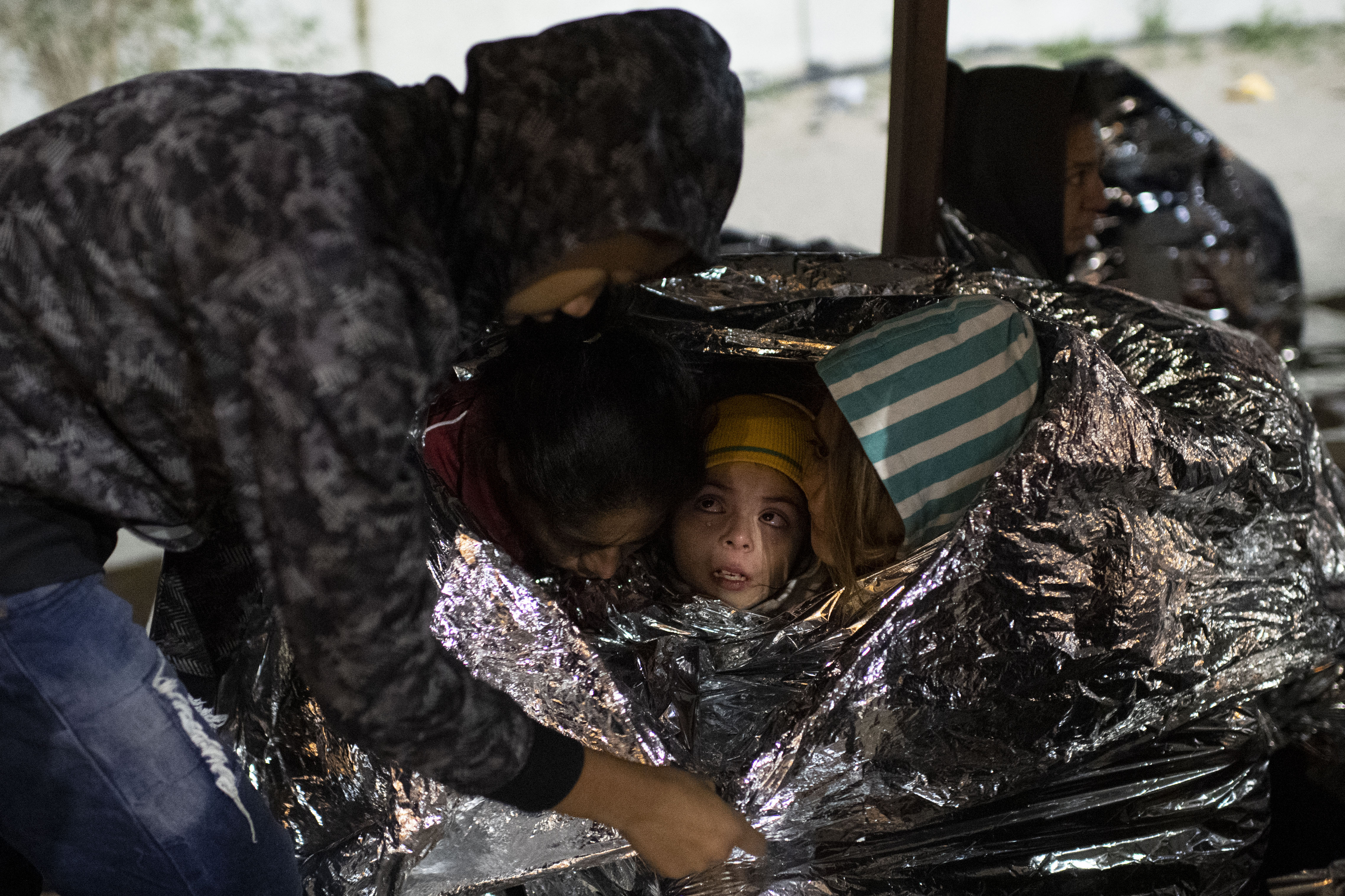 After walking across the Rio Grande on Feb. 22, a group of 64 Central American migrants arrived near El Paso and waited to be processed amid near-freezing temperatures. In a shift to immigration patterns, more unauthorized migrant adults are traveling with children.