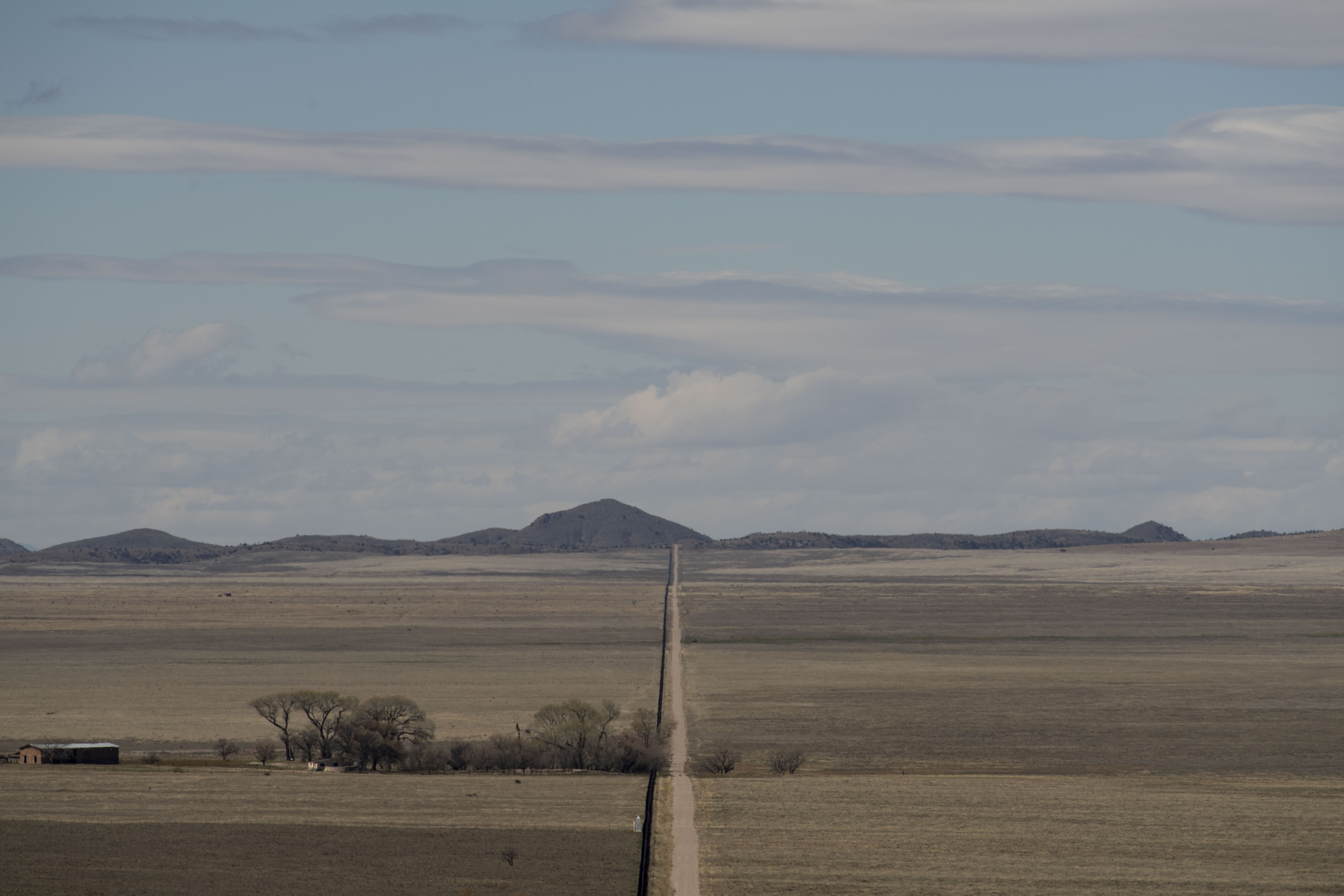 The border fence is seen from the Diamond A Ranch in Antelope Wells, N.M., on Feb. 21. Mexico is to the left of the fence and the United States is to the right.