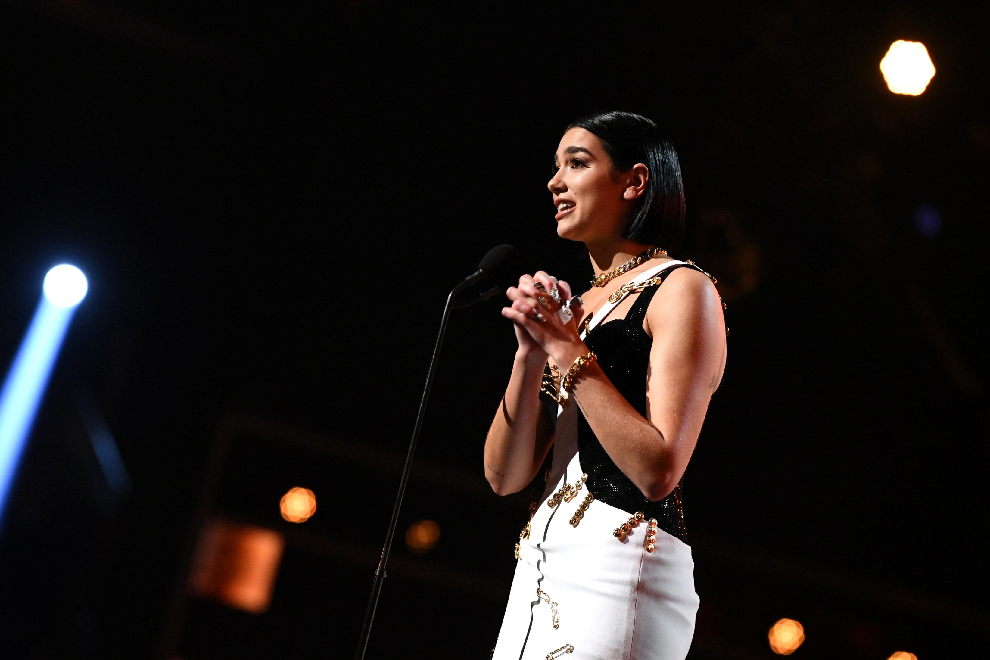 Dua Lipa accepts the Grammy for best new artist.