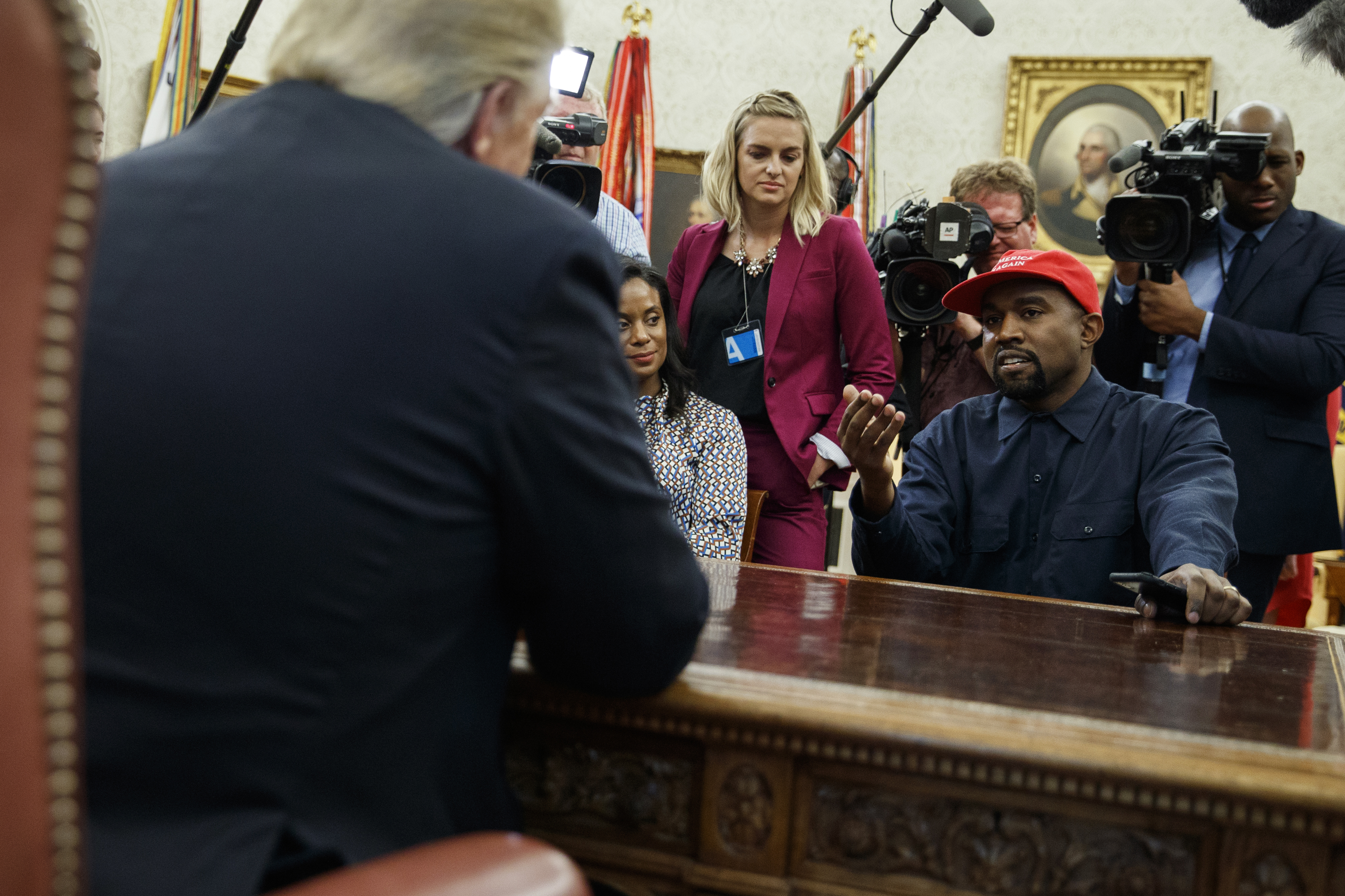 Fox swooned over Kanye West at the White House. Here's how it covered rappers visiting Obama.