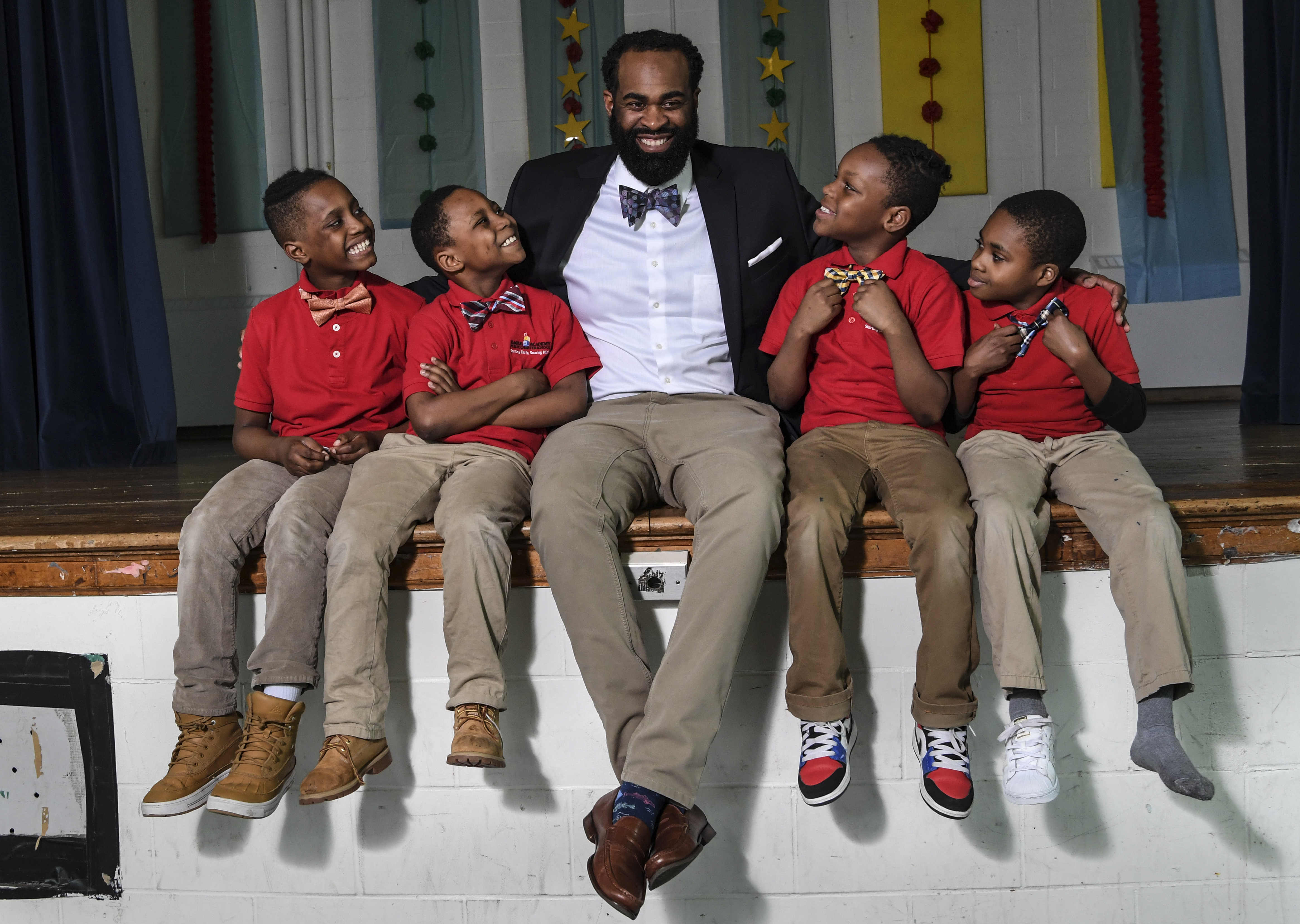 This charter school principal dresses for Wall Street, so his