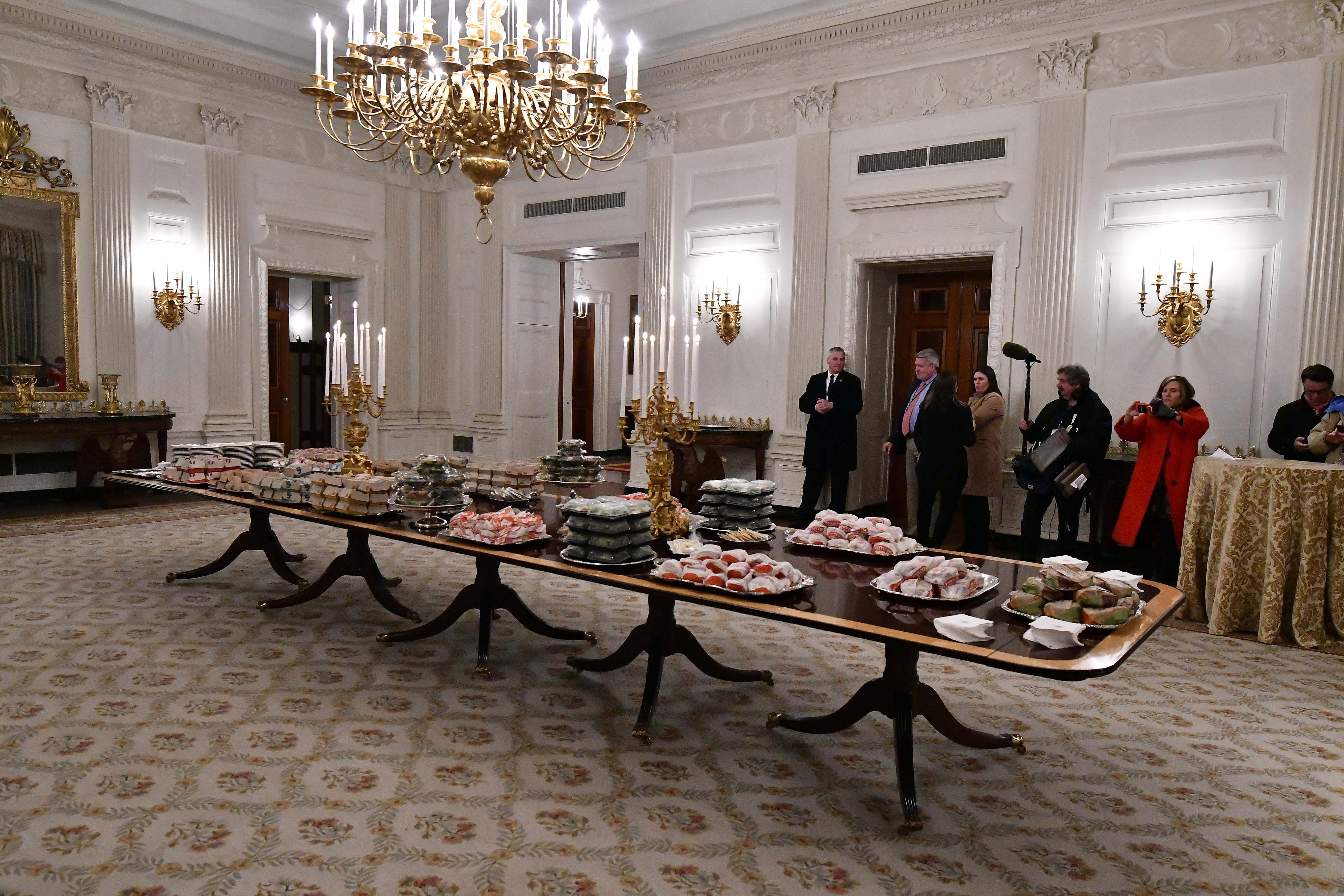 Fast food is shown in the State Dinning Room in the East Room of the White House.