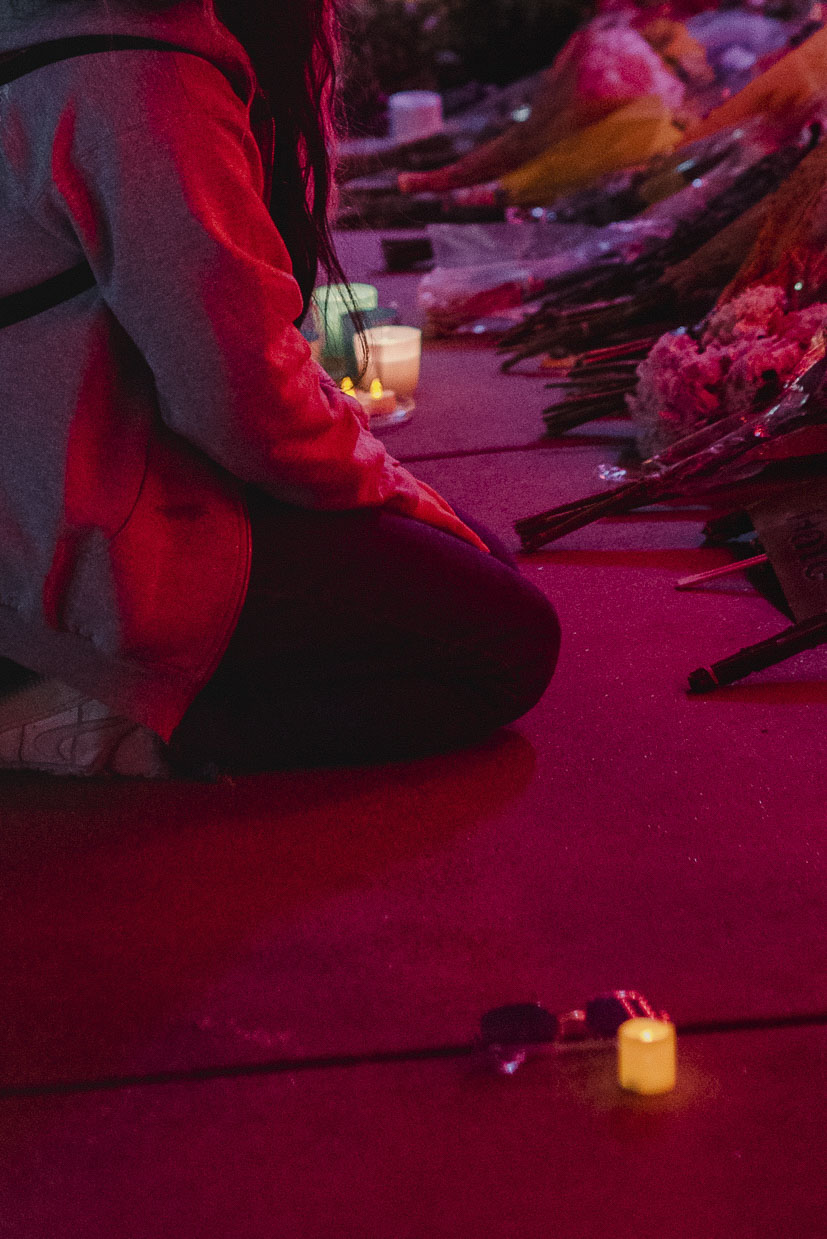 Yoo Jeong Lee kneels to pay respects at a memorial outside Gold Spa in Atlanta.