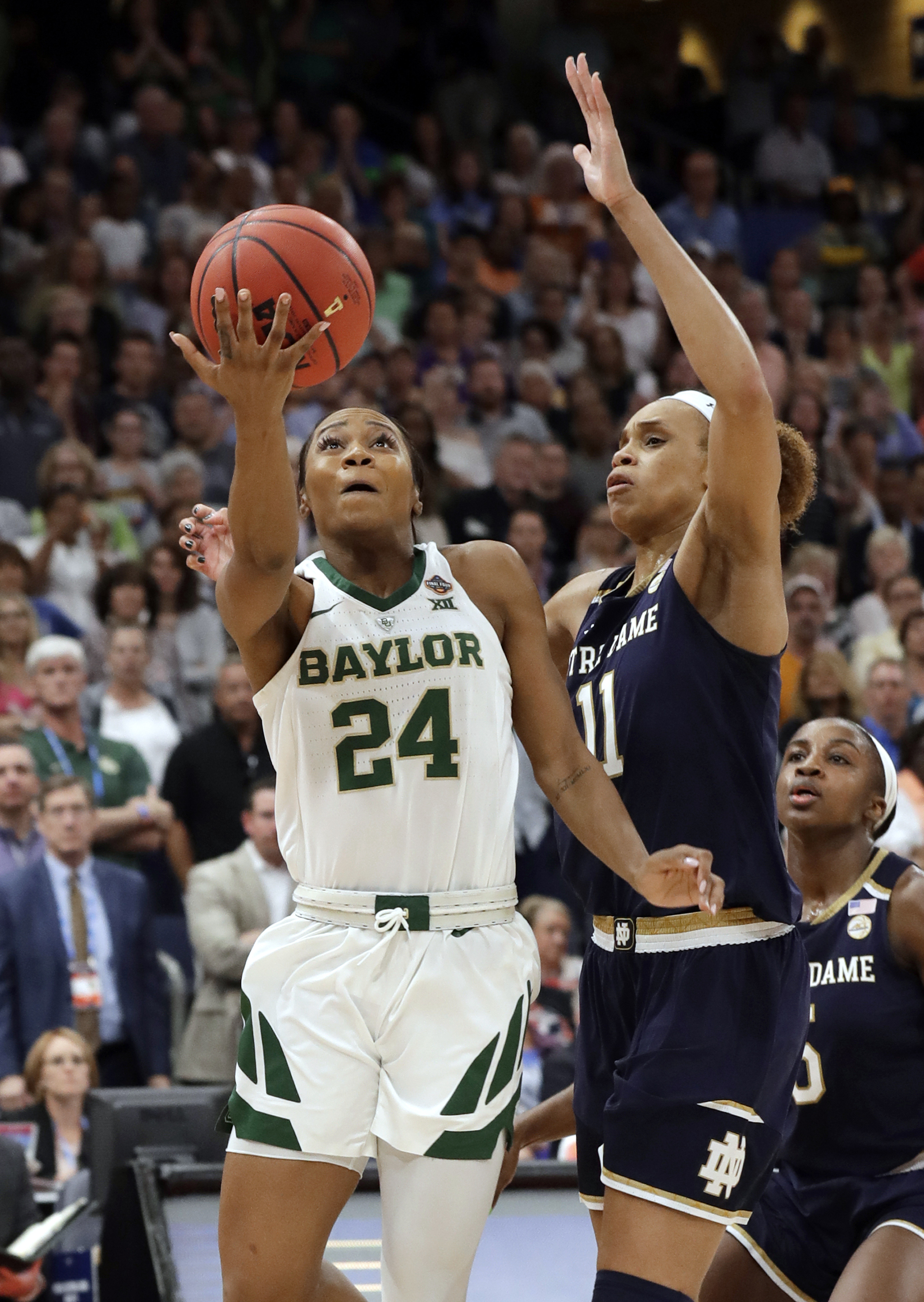 Baylor guard Chloe Jackson gets past Notre Dame forward Brianna Turner for the winning basket.
