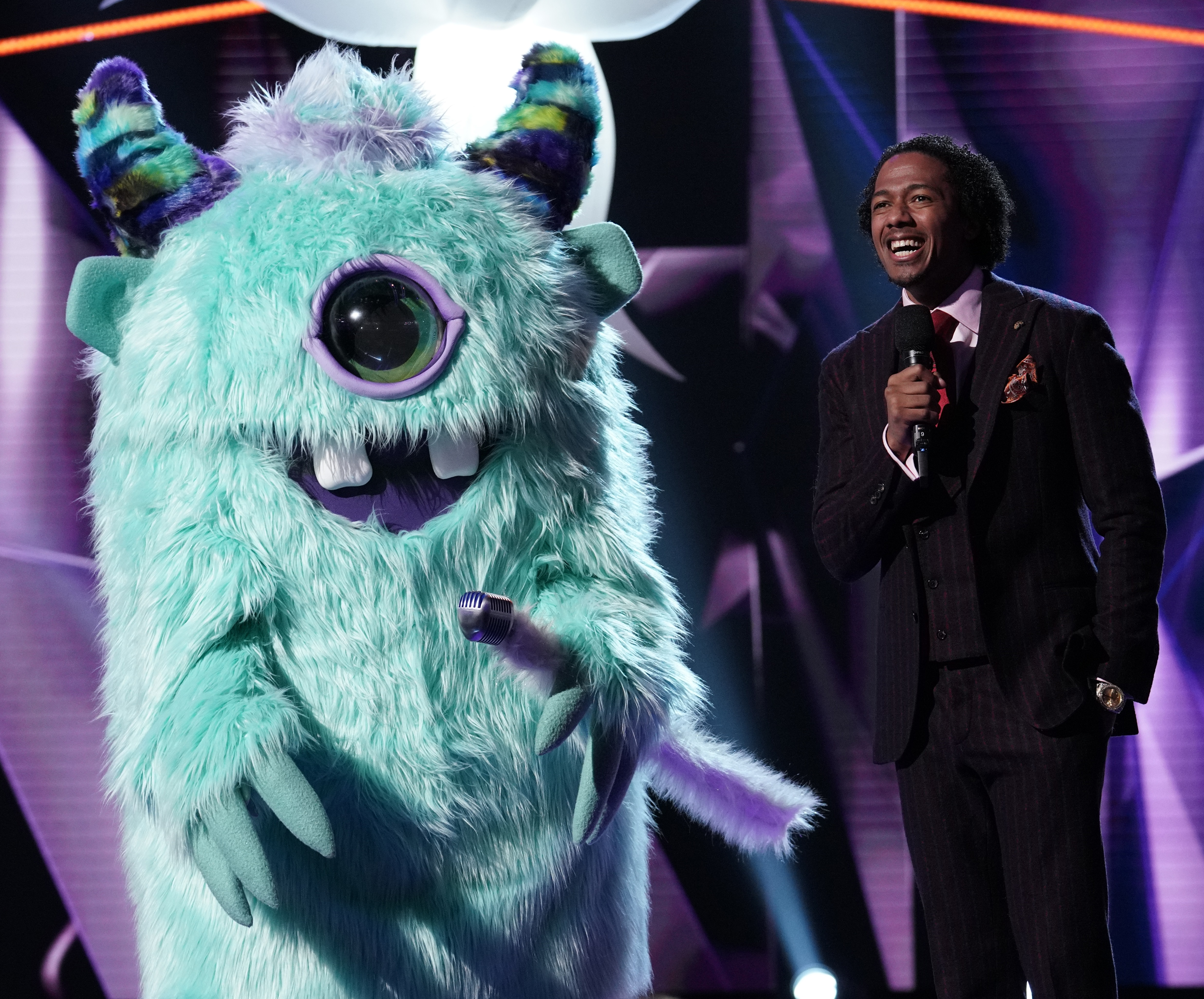 """The monster and host Nick Cannon in """"The Masked Singer."""" (Michael Becker/Fox)"""
