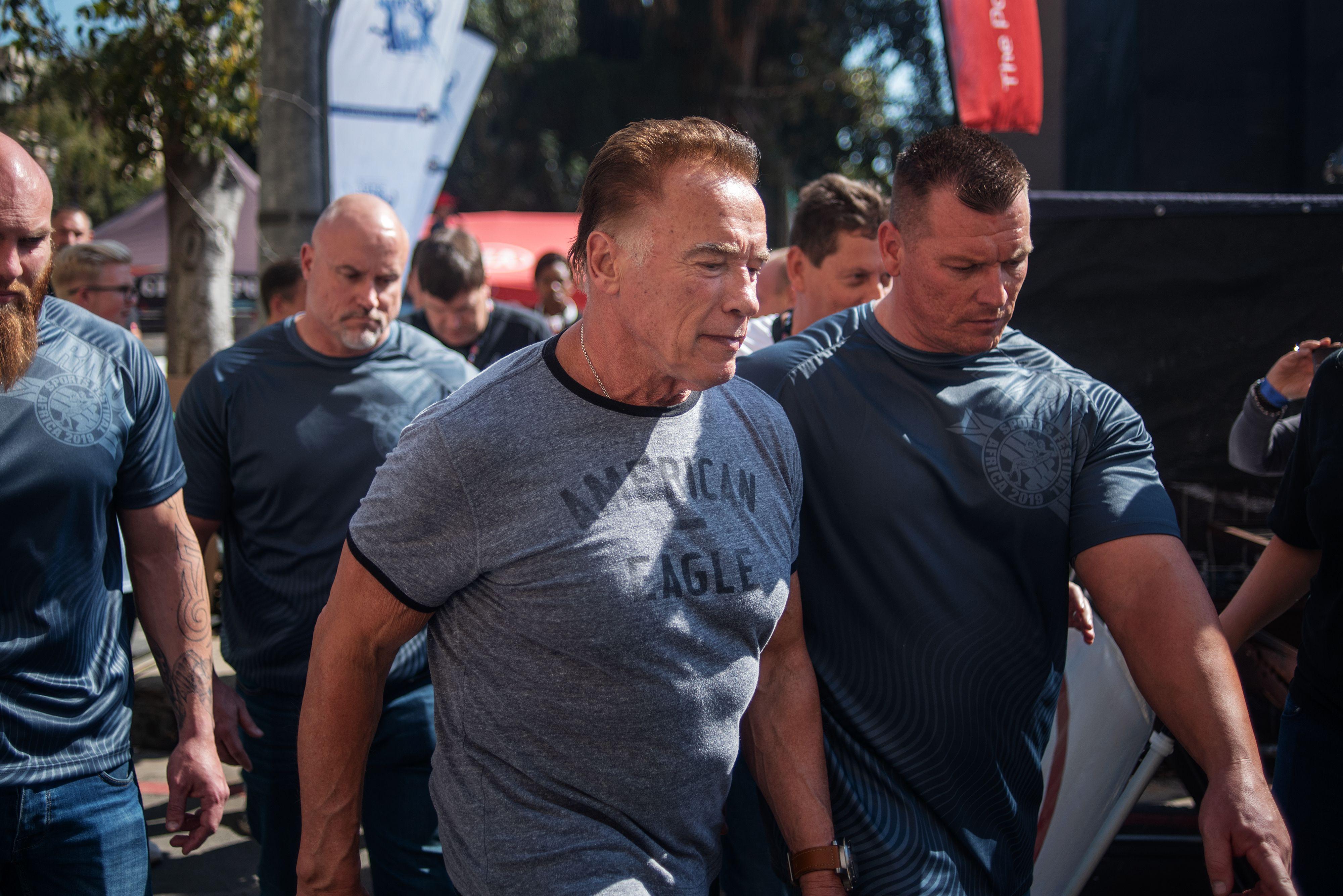 Arnold Schwarzenegger drop-kicked in back in South Africa