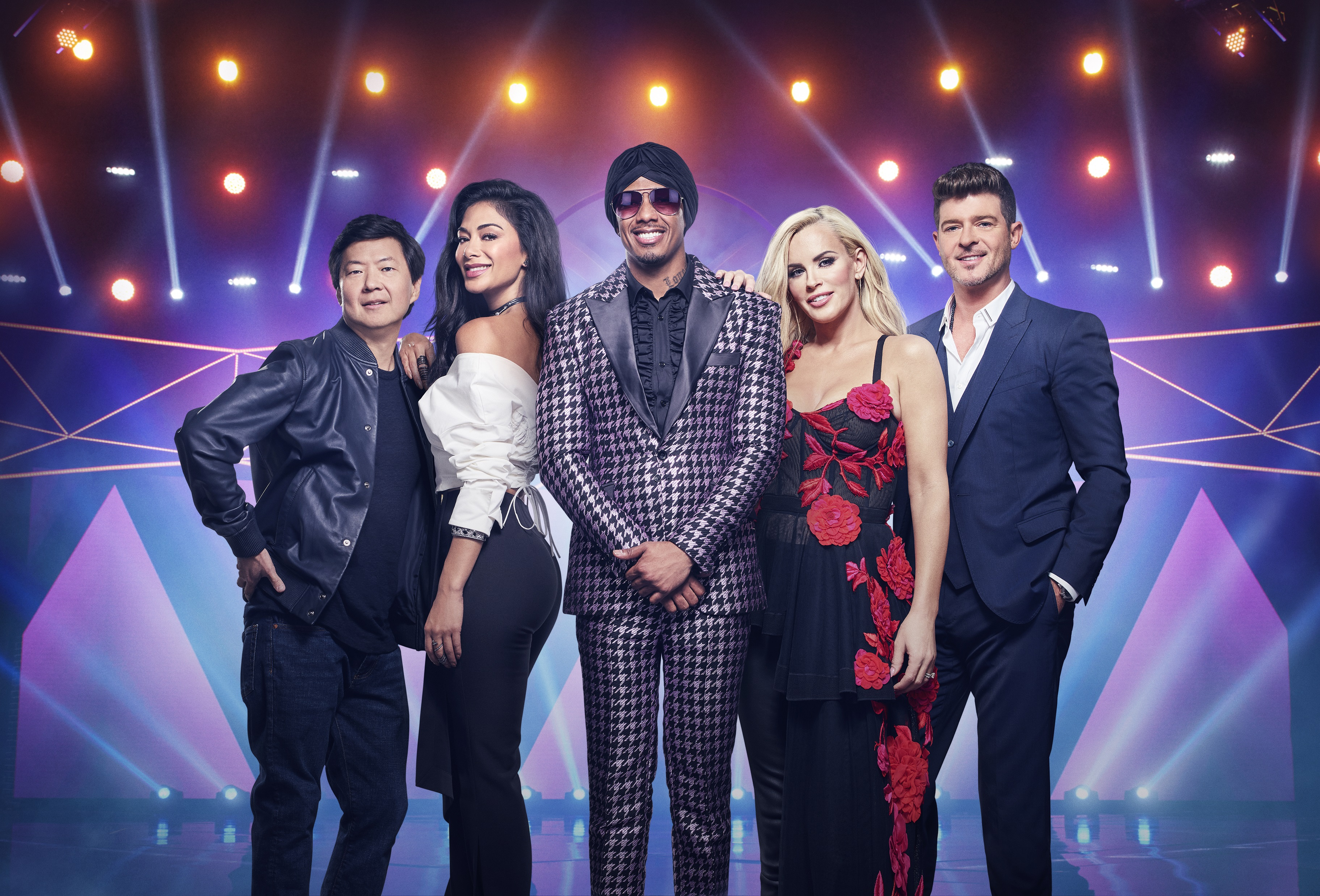 """From left: Ken Jeong, Nicole Scherzinger, Nick Cannon, Jenny McCarthy and Robin Thicke from """"The Masked Singer."""" (Michael Becker/Fox)"""