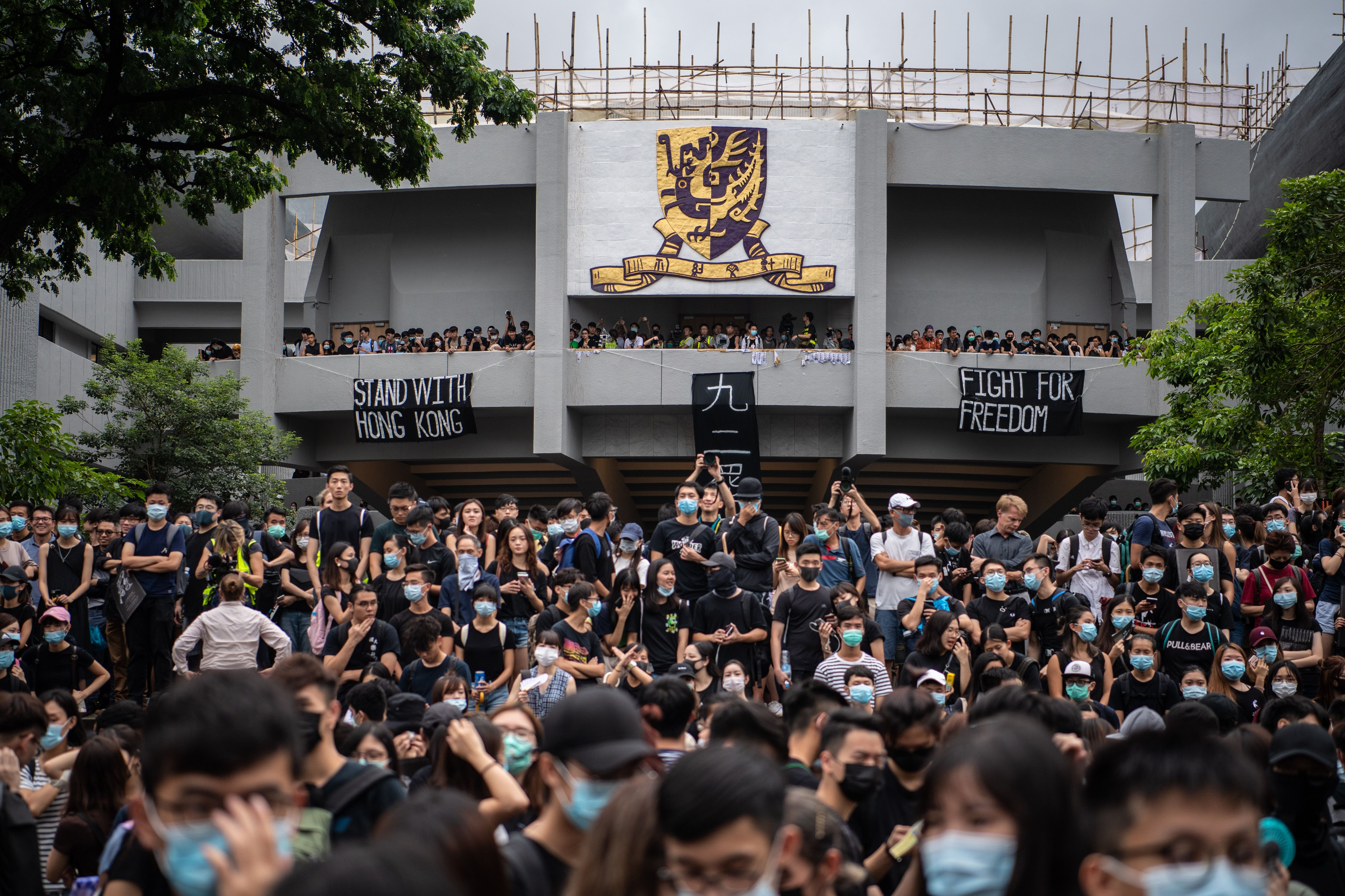 With threats and propaganda, China tries to silence support for Hong Kong protests