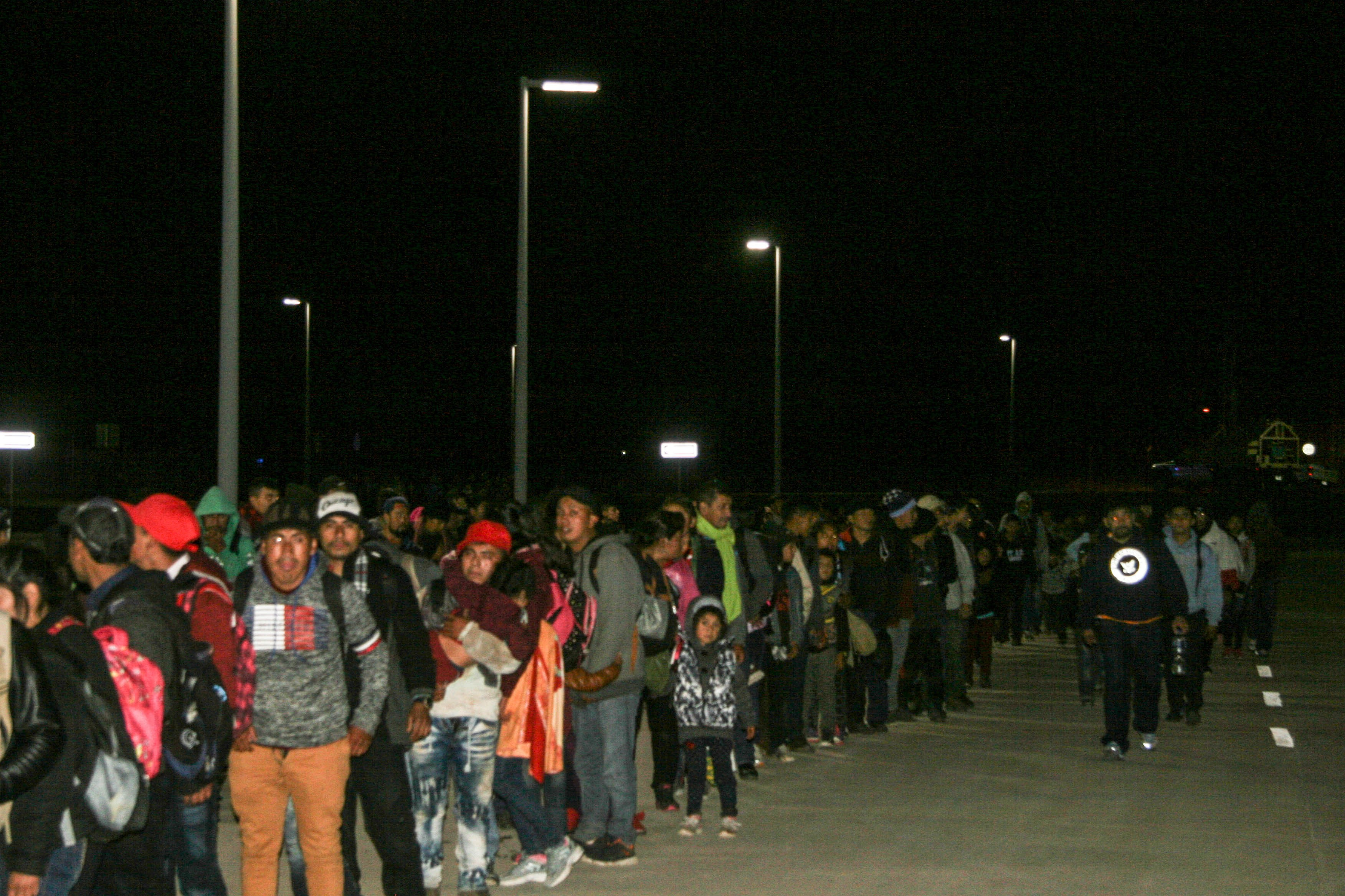"""A large group of migrants, who arrived as part of the """"Conveyor Belt"""" described in U.S. documents, waits near the Antelope Wells Port of Entry in Hidalgo County, N.M. (Obtained by The Washington Post)"""