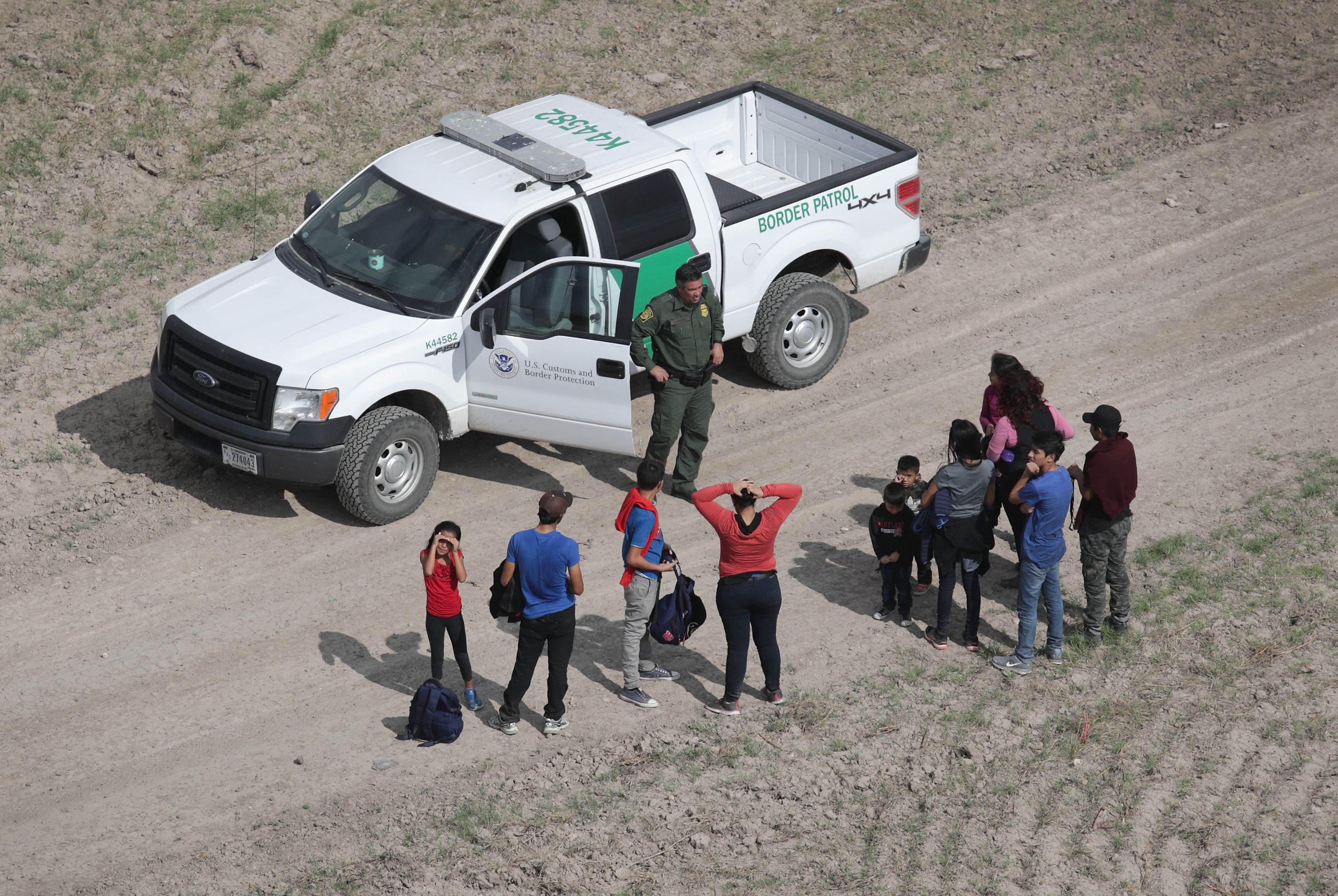 Trump administration tightens immigration asylum rules as caravans approach
