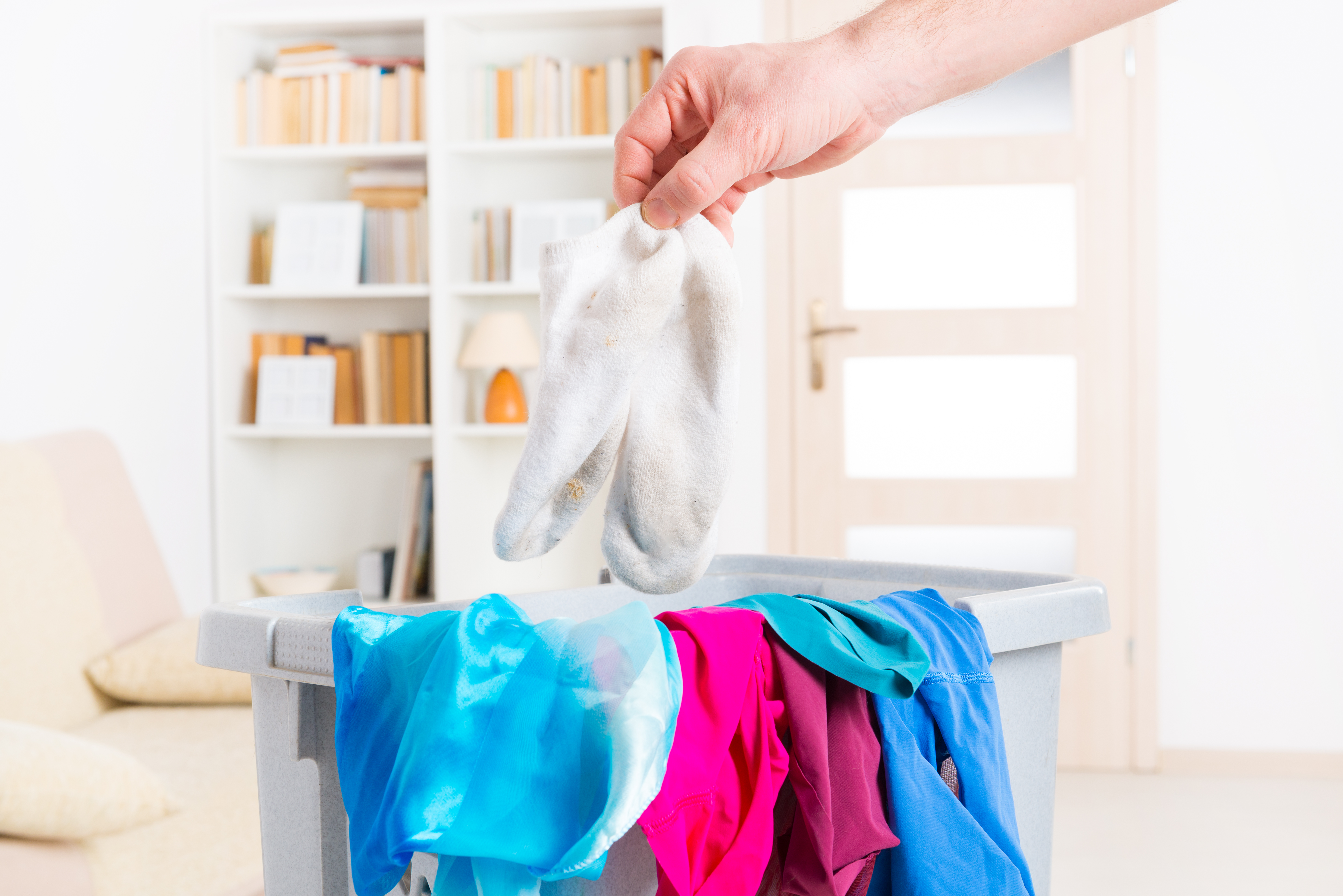 This Is Why Your Workout Clothes Still Stink After Being Washed