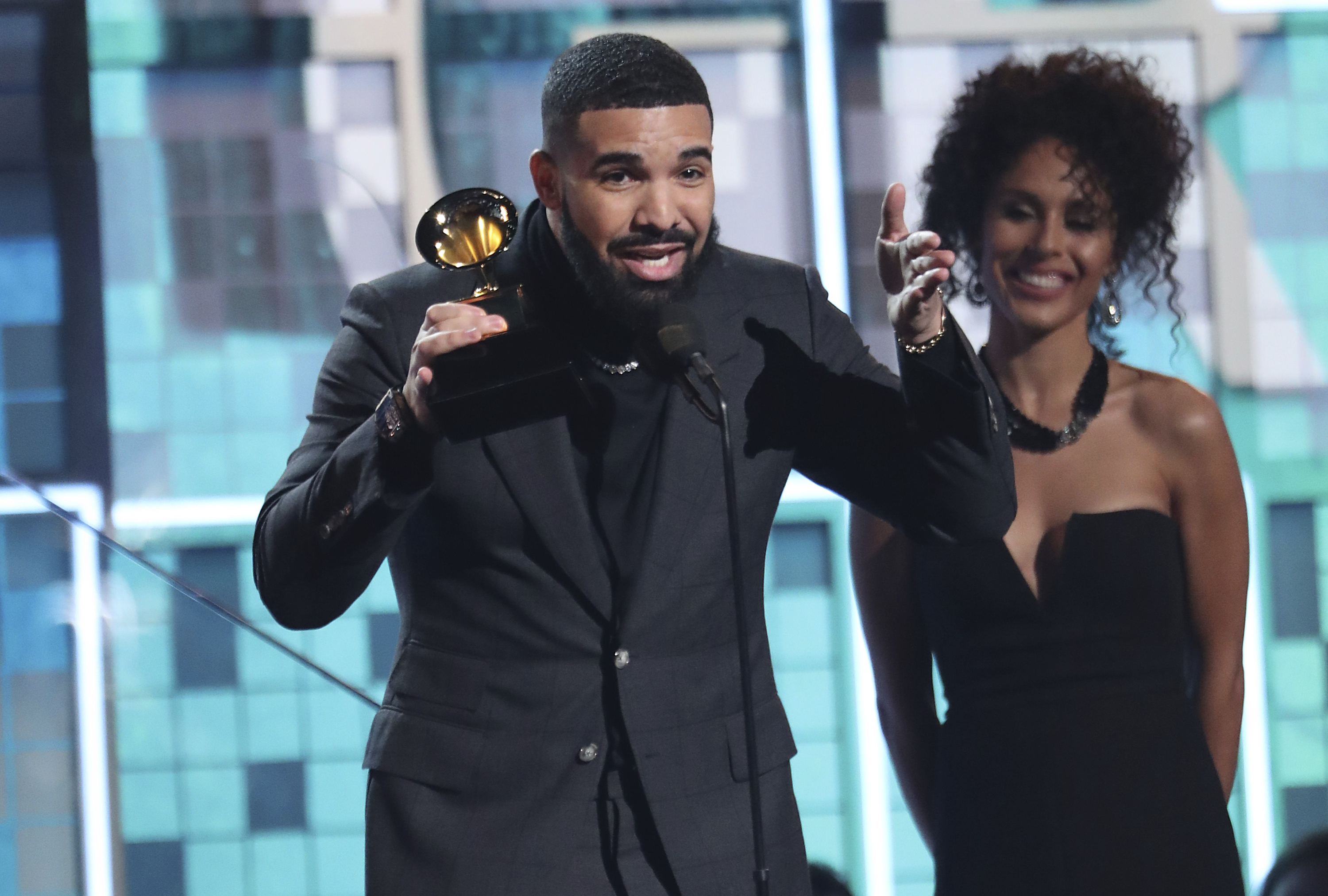 """Drake accepts the award for best rap song for """"God's Plan."""" (Matt Sayles/Invision/AP)"""