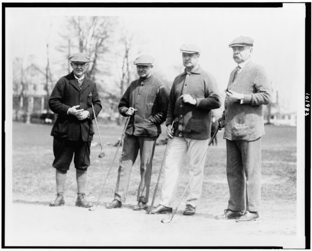 Left to right: Secretary of Interior Judge John Barton Payne; Moreven Thompson of Washington, D.C.; Secretary of Treasury David Franklin Houston; and former senator Willard Saulsbury at the Chevy Chase Club in Chevy Chase, Md. (Library of Congress)