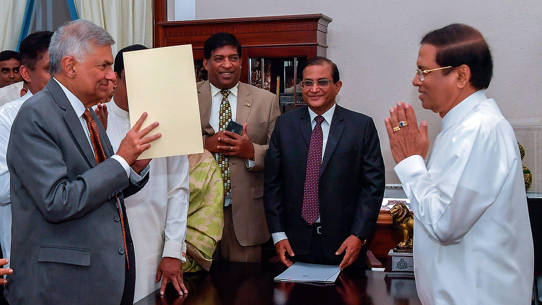 Sri Lanka's prime minister reinstated, ending political
