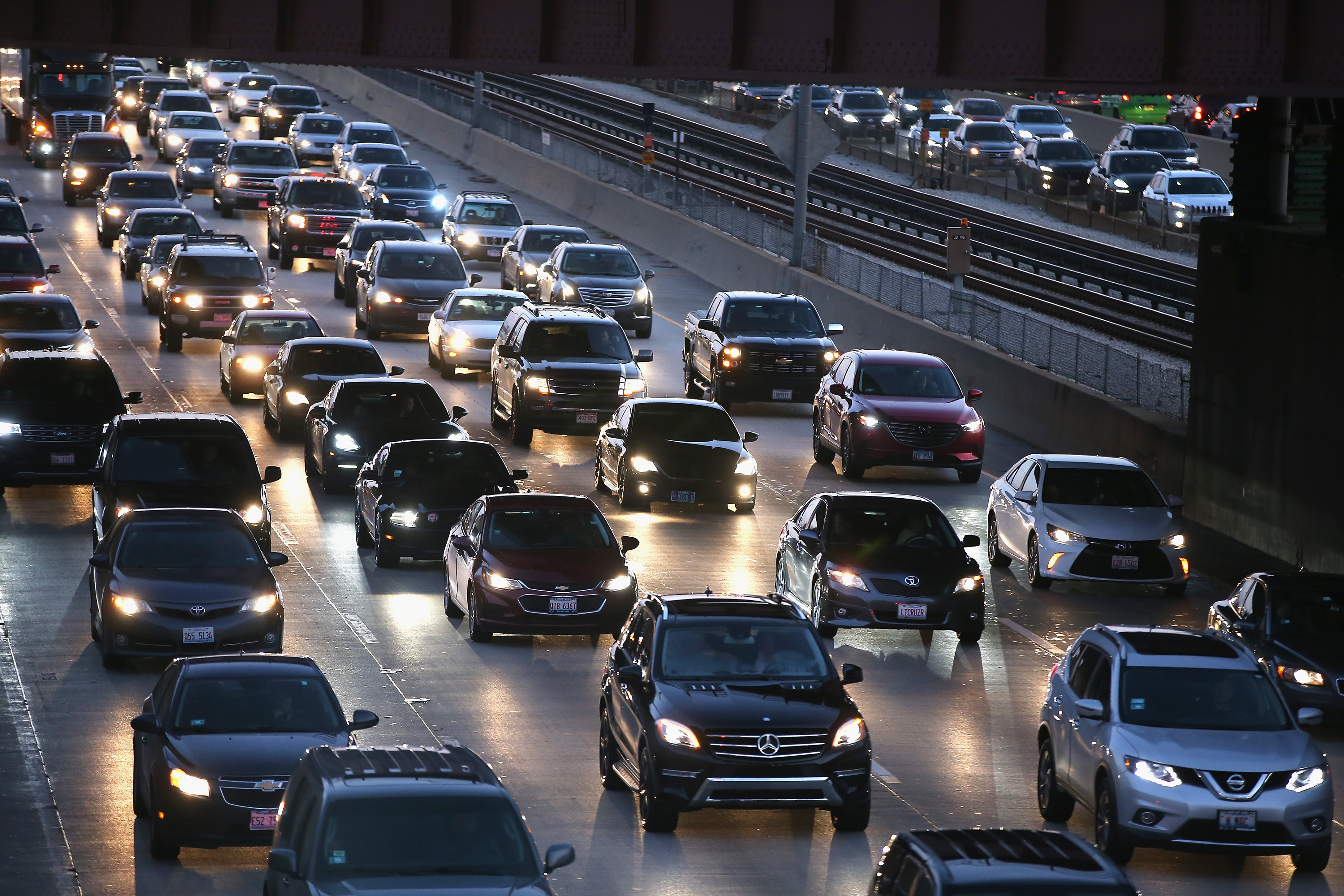 EPA to roll back car emissions standards, handing automakers