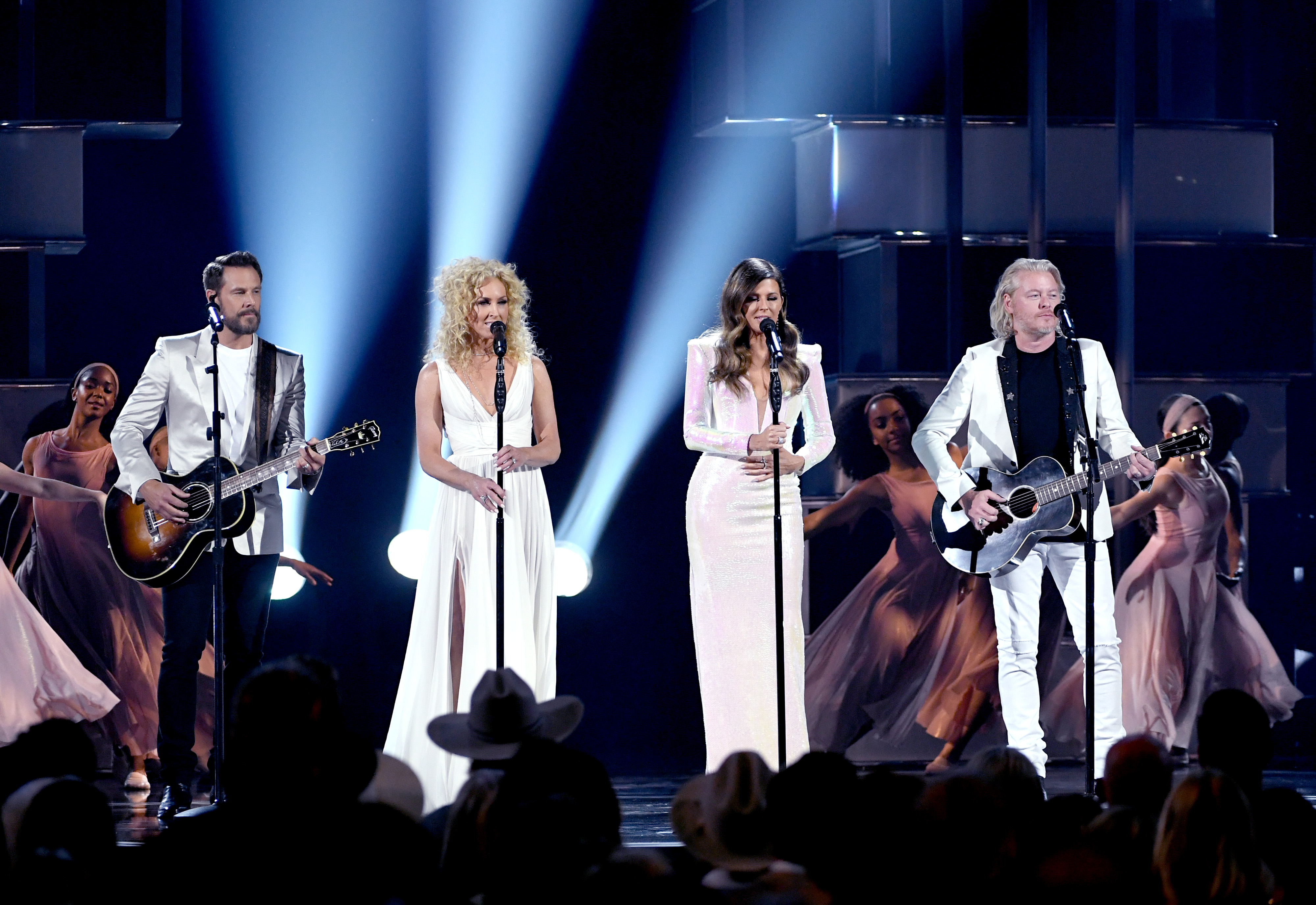 "Jimi Westbrook, Kimberly Schlapman, Karen Fairchild and Philip Sweet of Little Big Town perform ""The Daughters."" (Kevin Winter/Getty Images)"