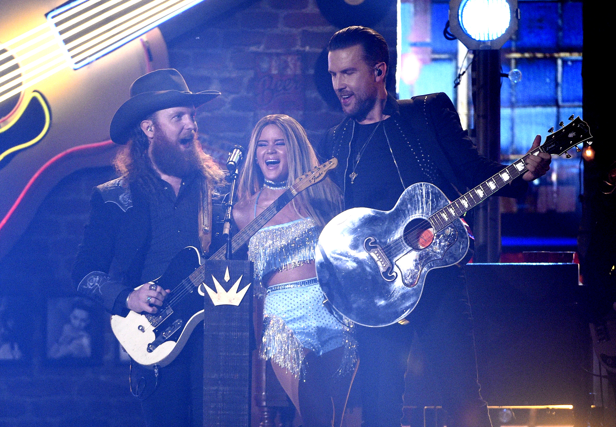 "John Osborne, left, and T.J. Osborne, right, of Brothers Osborne, and Maren Morris perform ""All My Favorite People."" (Chris Pizzello/Invision/AP)"