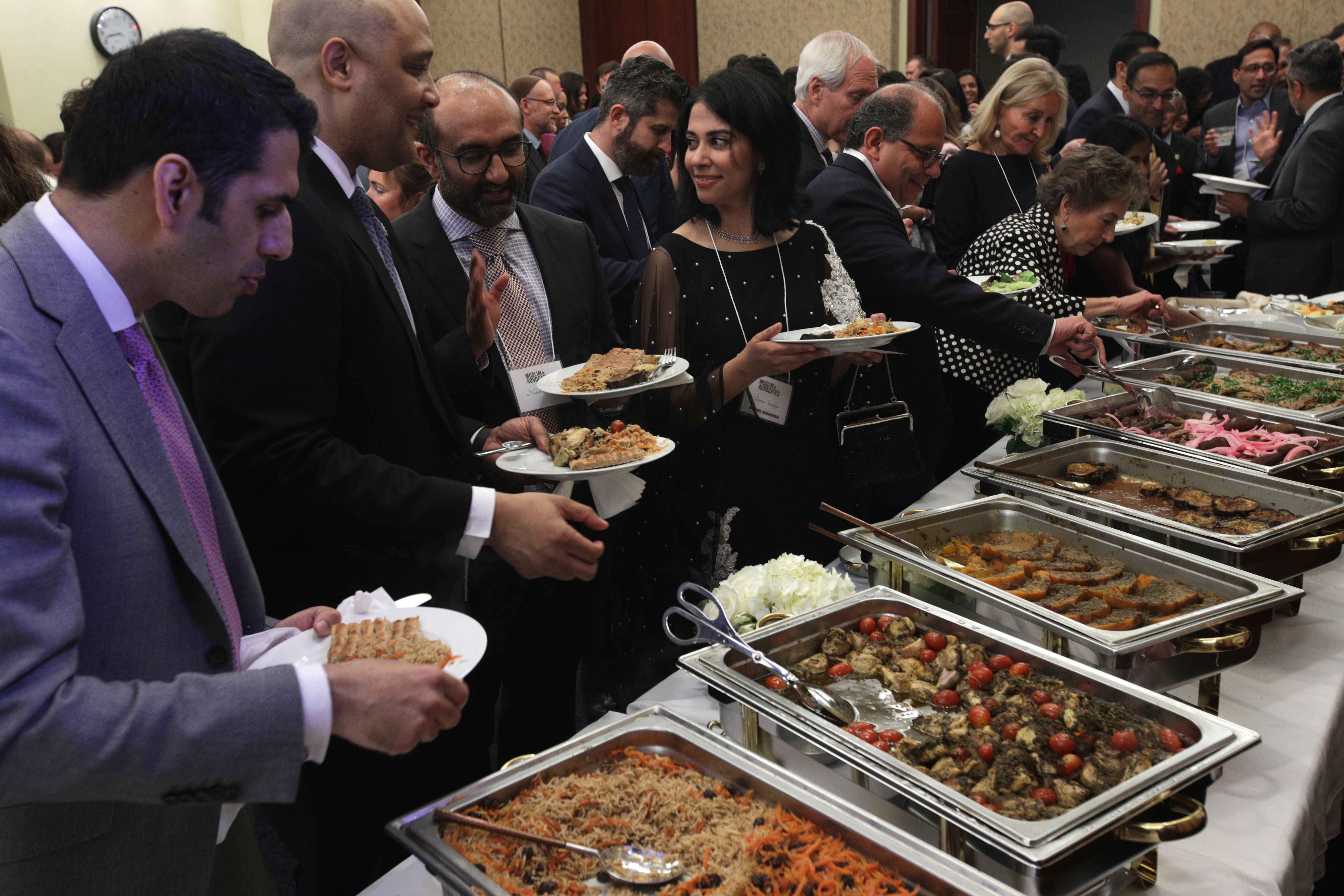 After an imam led a prayer to mark the end of the fast, guests flocked to the food at the congressional iftar.