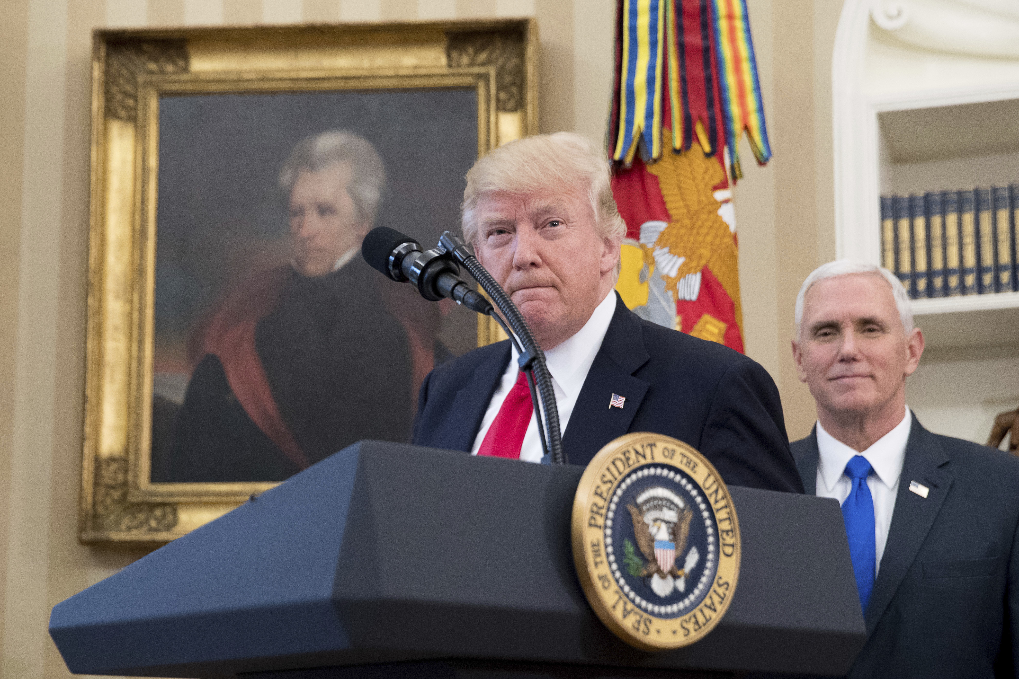 A portrait of President Andrew Jackson hangs on the wall behind President Donald Trump, accompanied by Vice President Mike Pence, in the Oval Office in 2017. (Andrew Harnik, File)