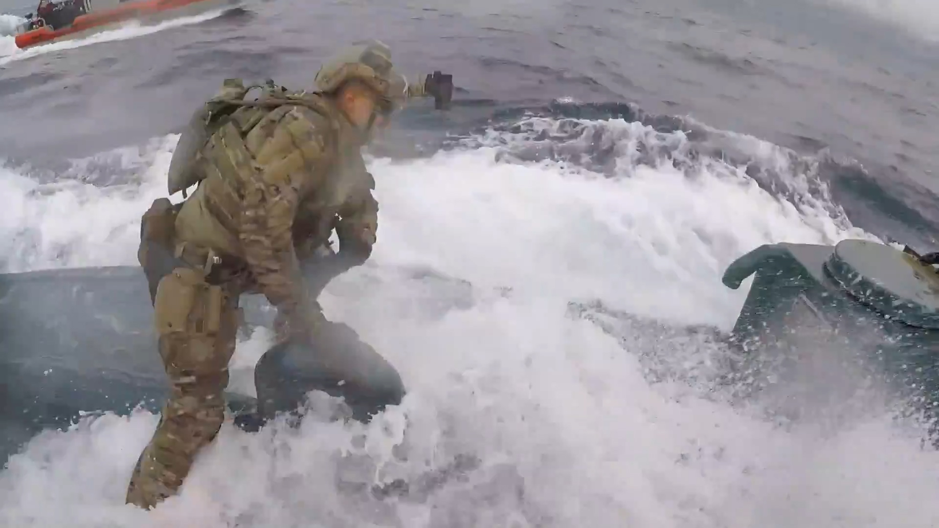 Watch a Coast Guardsman's dramatic leap onto a submarine suspected of drug  smuggling