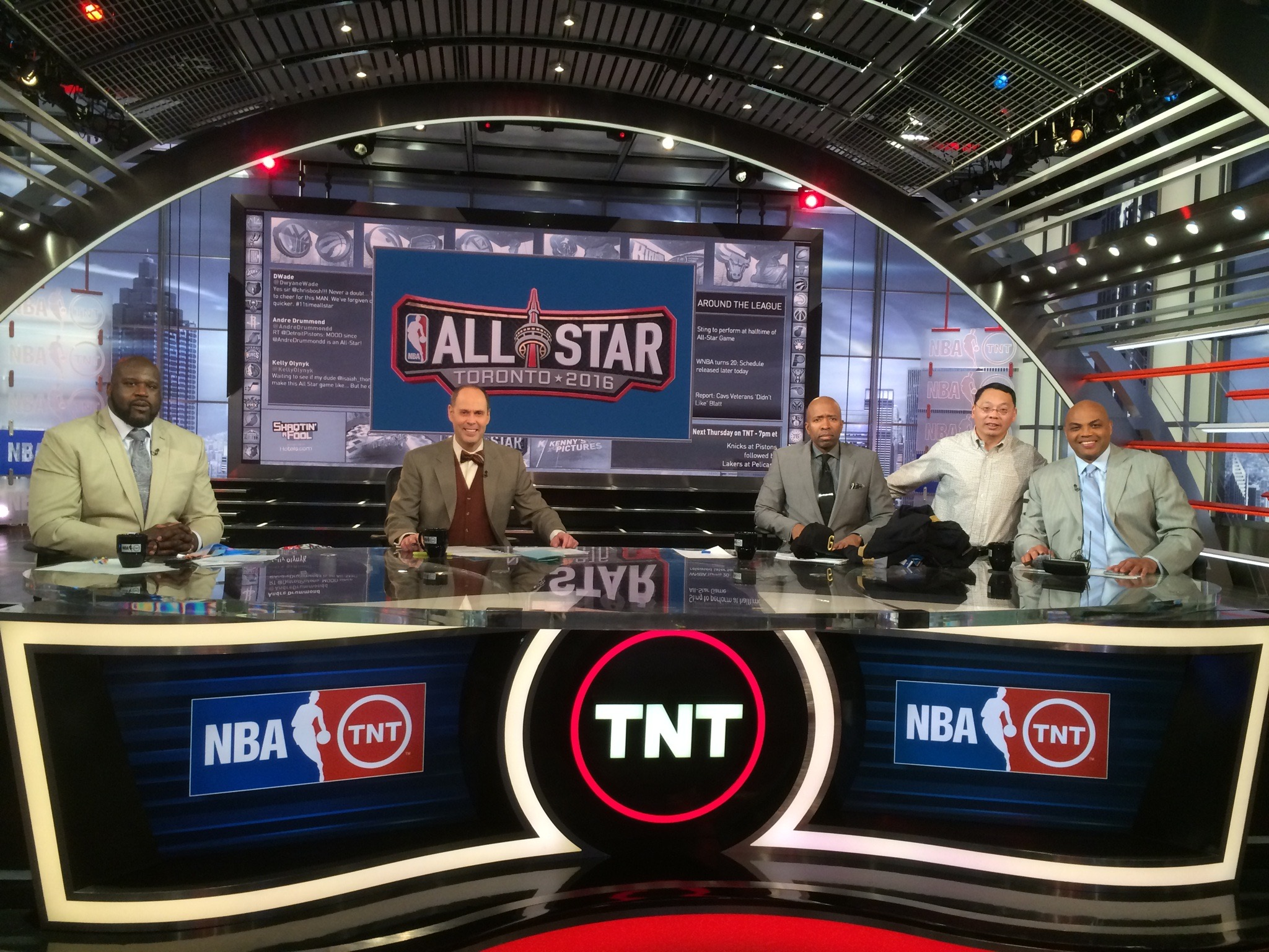 """Lin Wang, second from right, on the set of TNT's """"Inside the NBA"""" with Charles Barkley, Kenny Smith, Ernie Johnson and Shaquille O'Neal. (Shirley Wang)"""