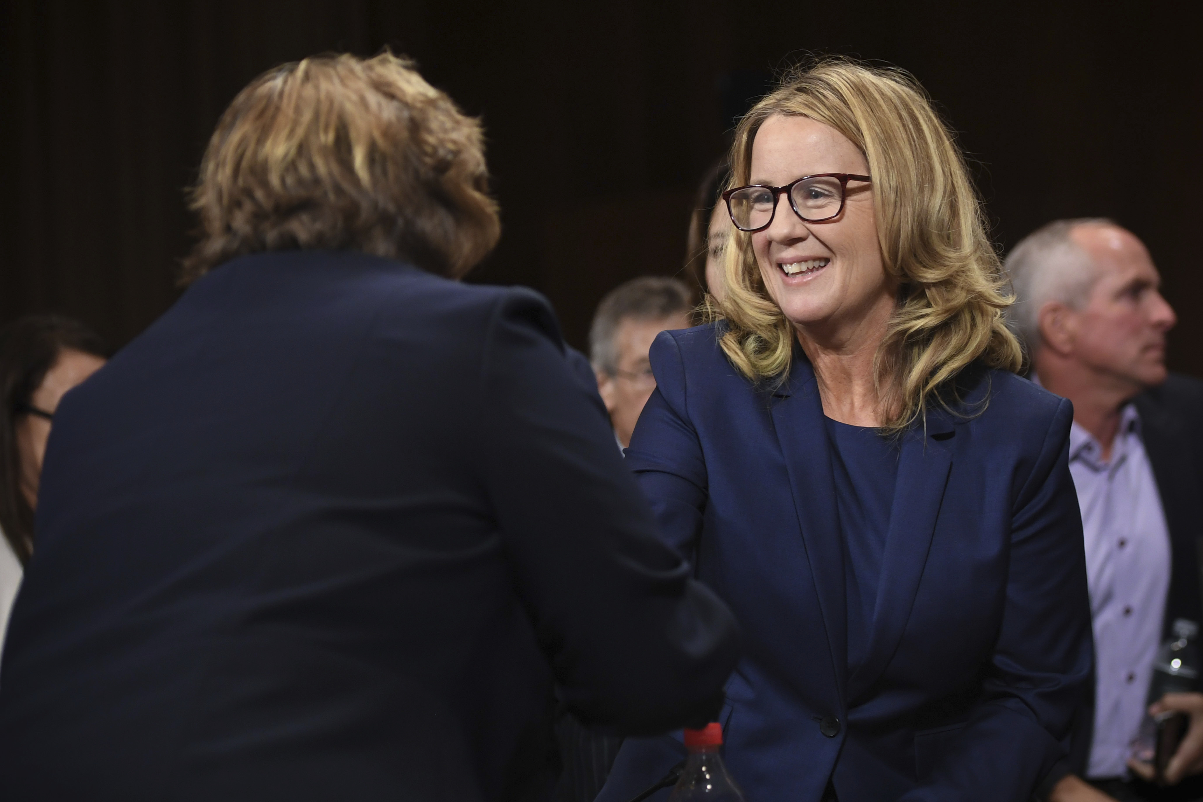 Christine Blasey Ford (R), the woman accusing Supreme Court nominee Brett Kavanaugh of sexually assaulting her at a party 36 years ago, shakes hands with Rachel Mitchell, a prosecutor from Arizona, after she interrogated her before the US Senate Judiciary Committee on Capitol Hill in Washington, DC, September 27, 2018. (Saul Loeb/Pool Photo via AP)