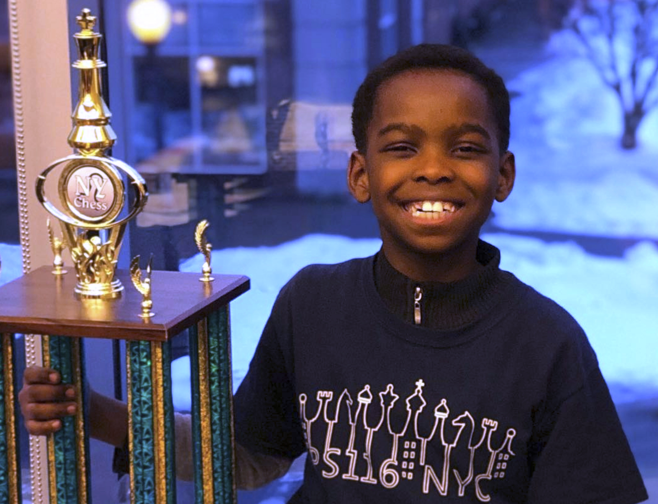 The heart-warming tale of the 8-year-old chess champion is quintessentially American