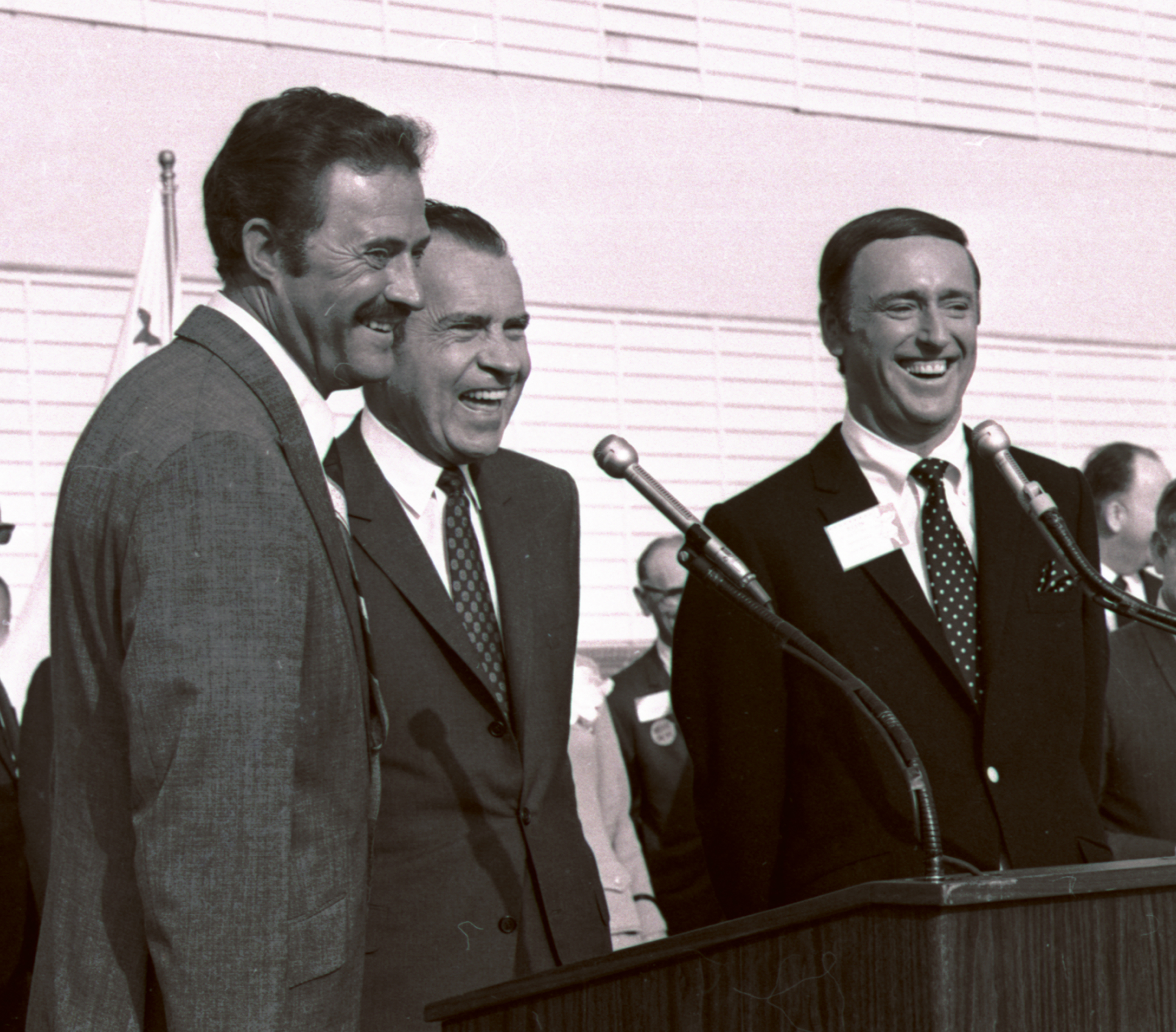"Comedians Dan Rowan, left, and Dick Martin, hosts of ""Rowan and Martin's Laugh-In"" flanking GOP presidential candidate Richard Nixon during a rally in Burbank, Calif., in 1968. Nixon dropped in on the show to shout a befuddled sounding, ""Sock it to me!"" (AP Photo)"