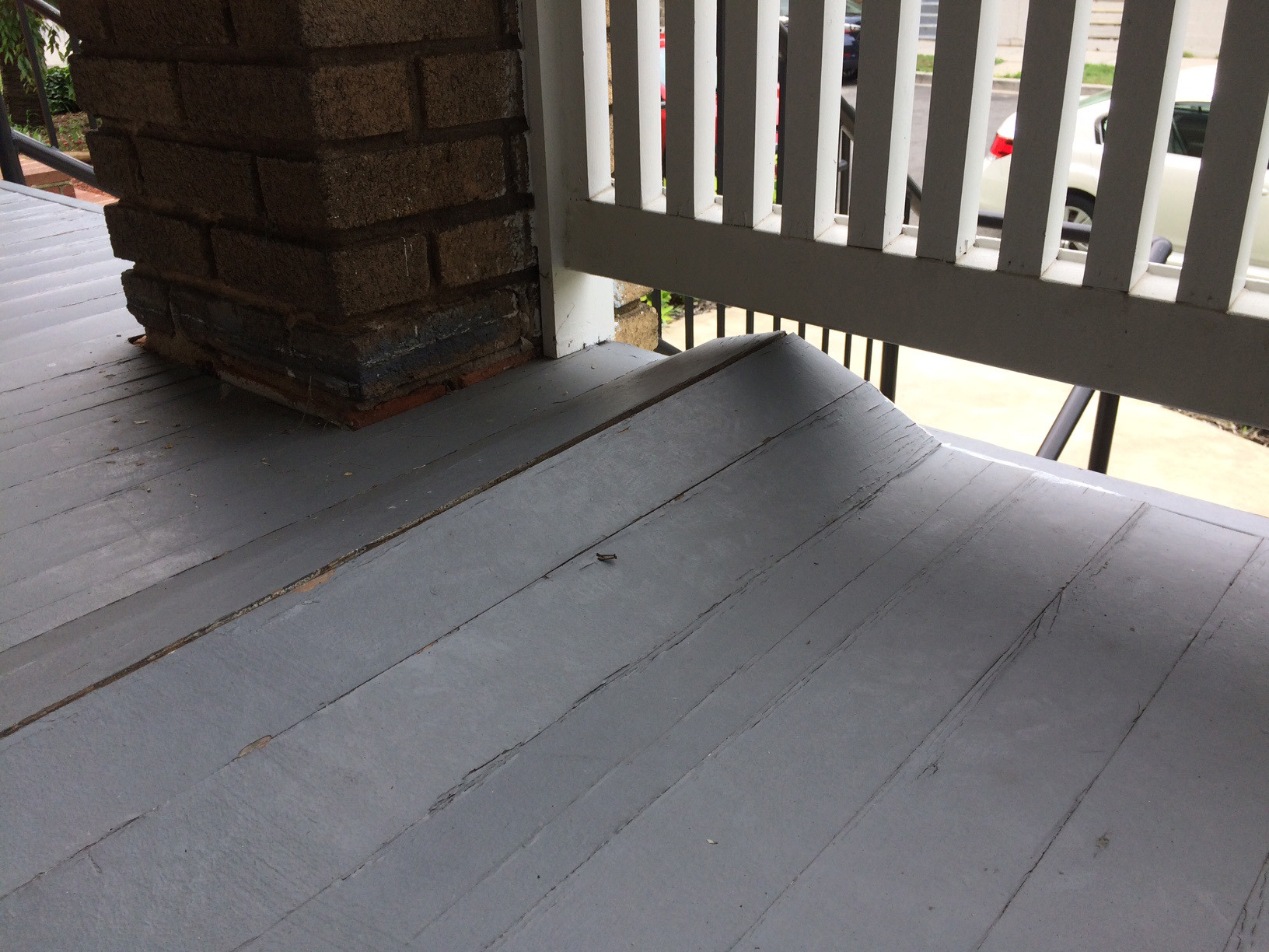 Dealing With A Wooden Porch That Buckles When It Rains The