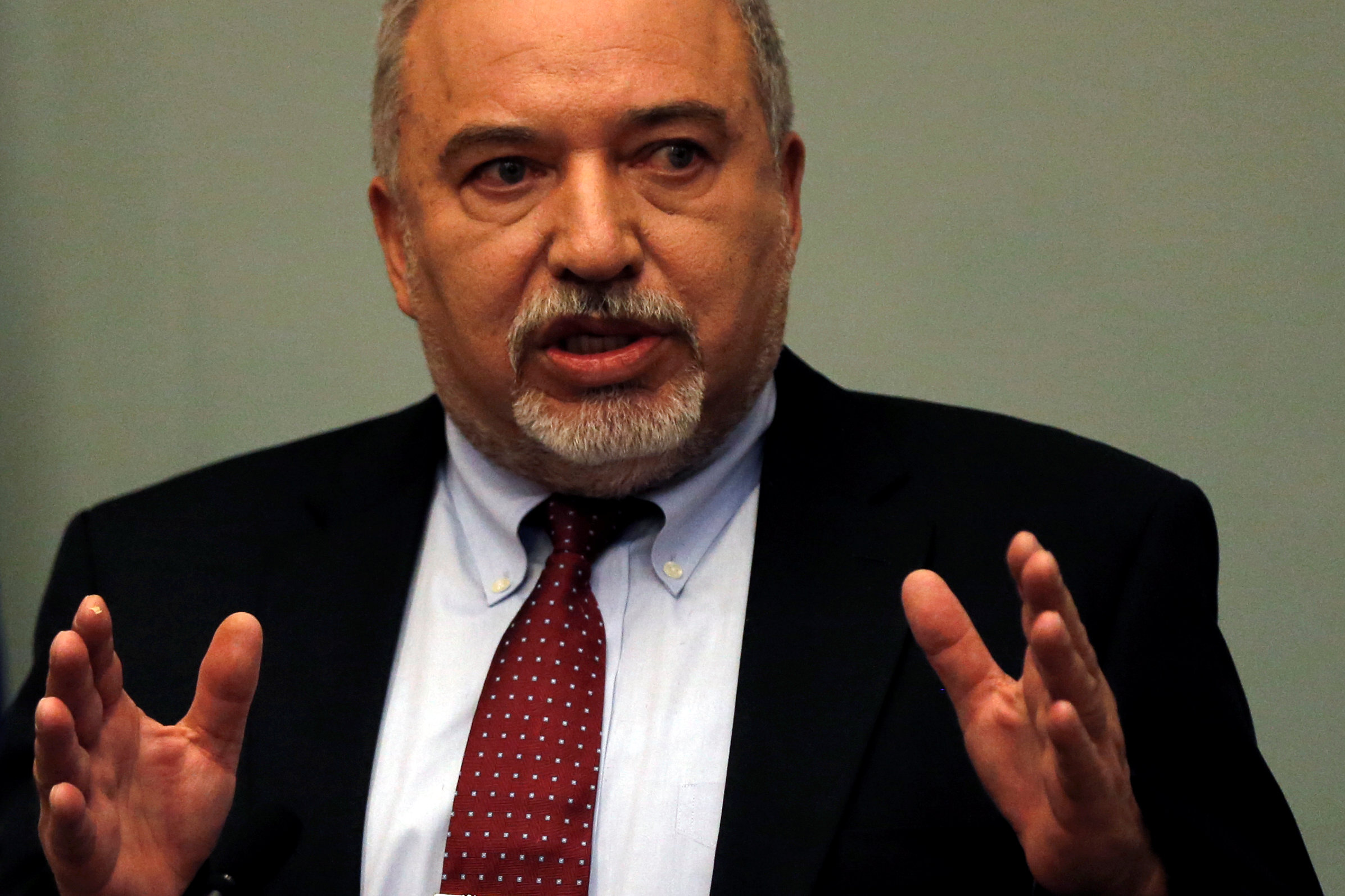 Israel's hawkish defense minister resigns from the government over Hamas truce