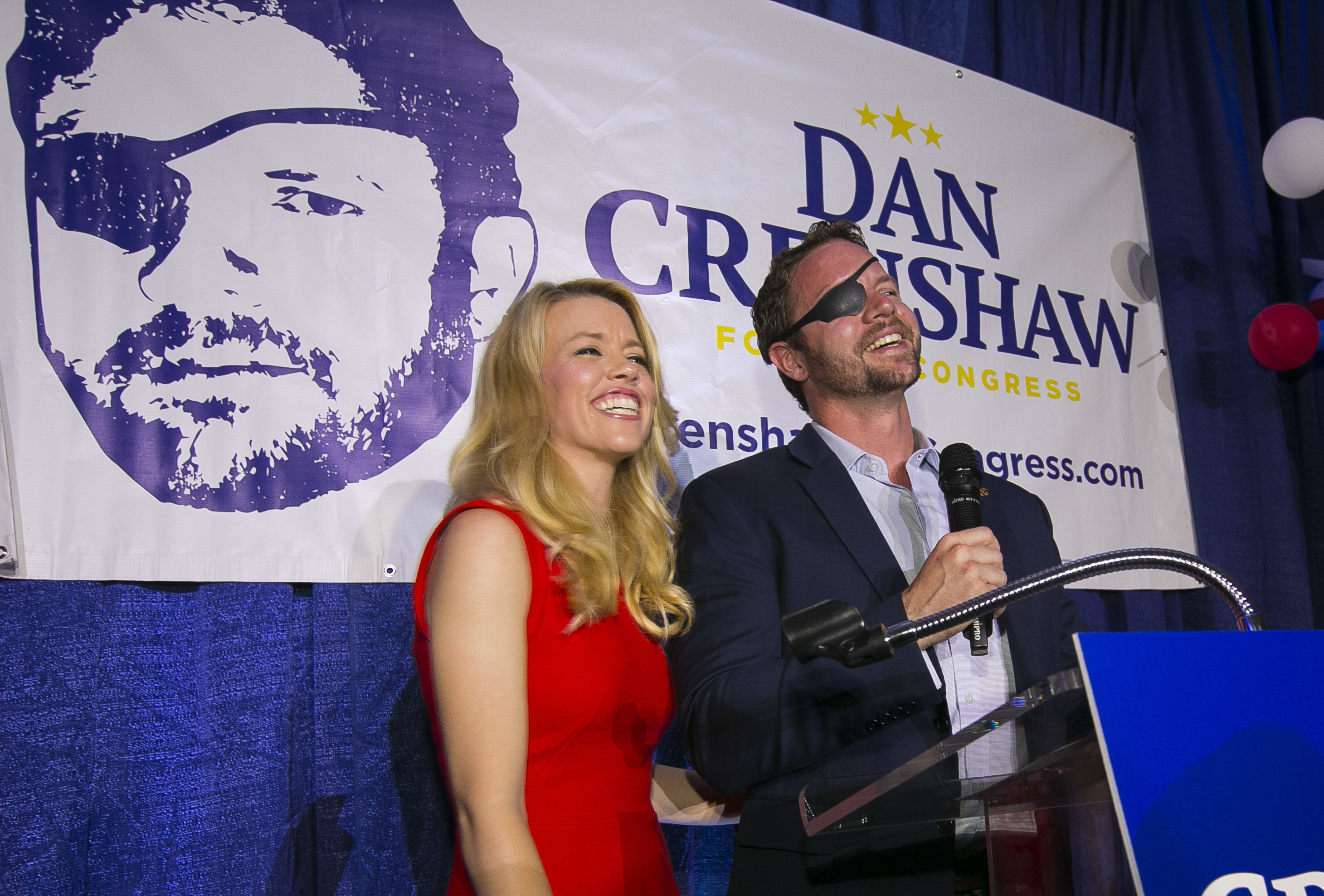 Crenshaw — shown with his wife, Tara, at his primary victory — lost an eye in Afghanistan.