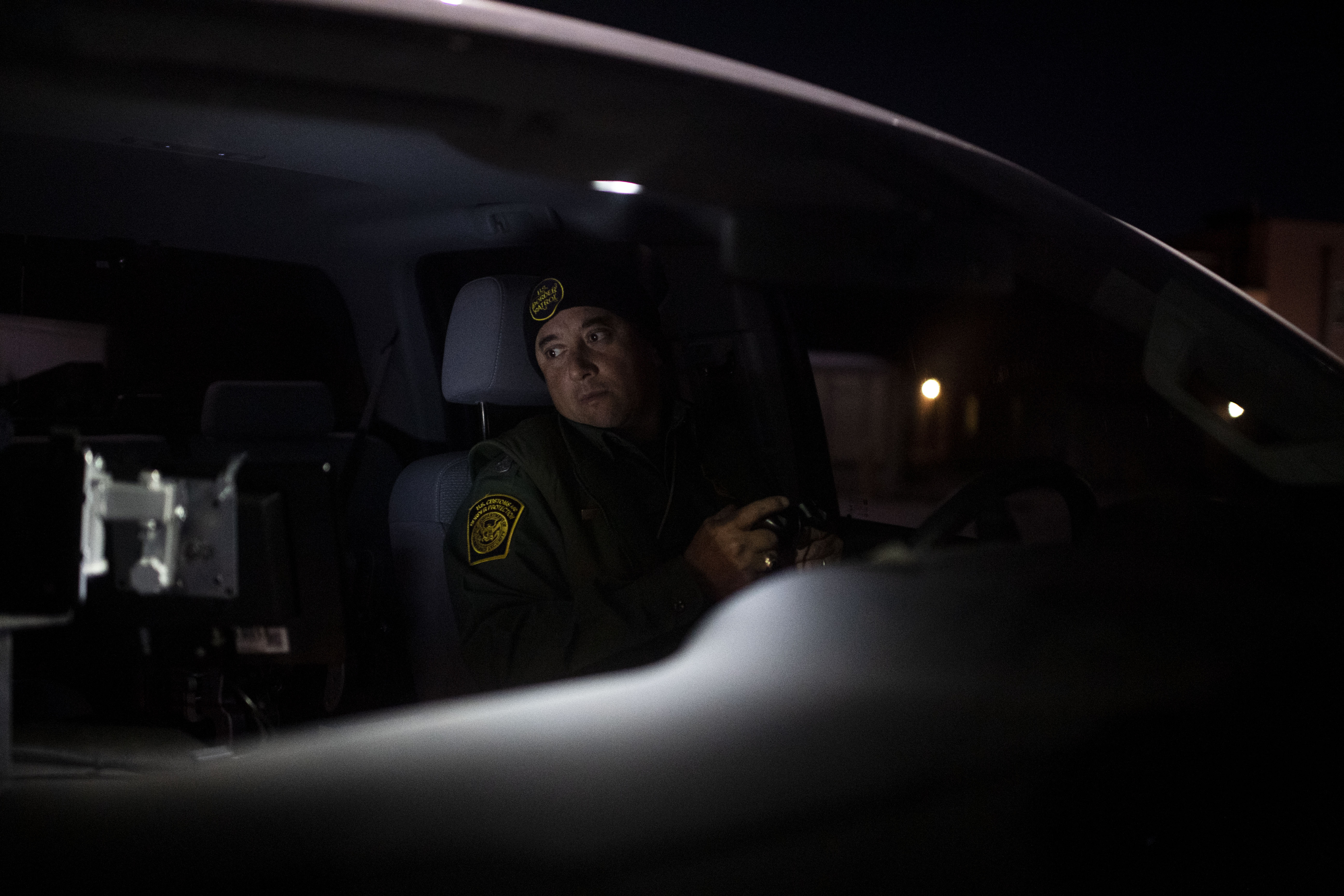 Border Patrol agent Ramiro Cordero uses a forward-looking infrared system to look for groups of migrants approaching the border in Antelope Wells, N.M., on Feb. 19. (Carolyn Van Houten/The Washington Post)