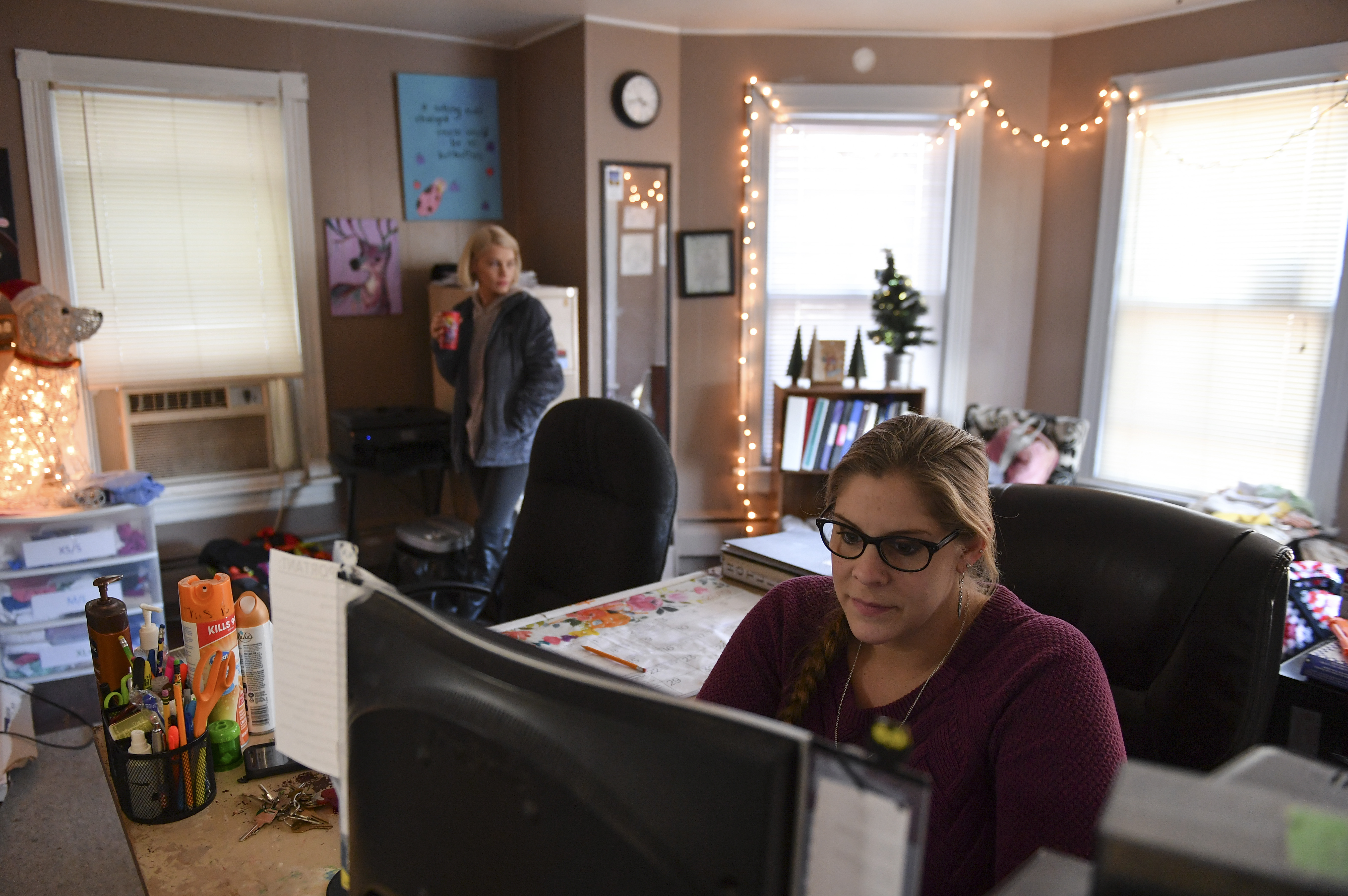 Mandi Howell, shelter manager, right, and shelter advocate Nycole Cooper, left, work at the Eastern Panhandle Empowerment Center women's shelter during the partial government shutdown. Federal grants have been extended until March, but the facility is operating on the edge with a staff uncertain of the future.