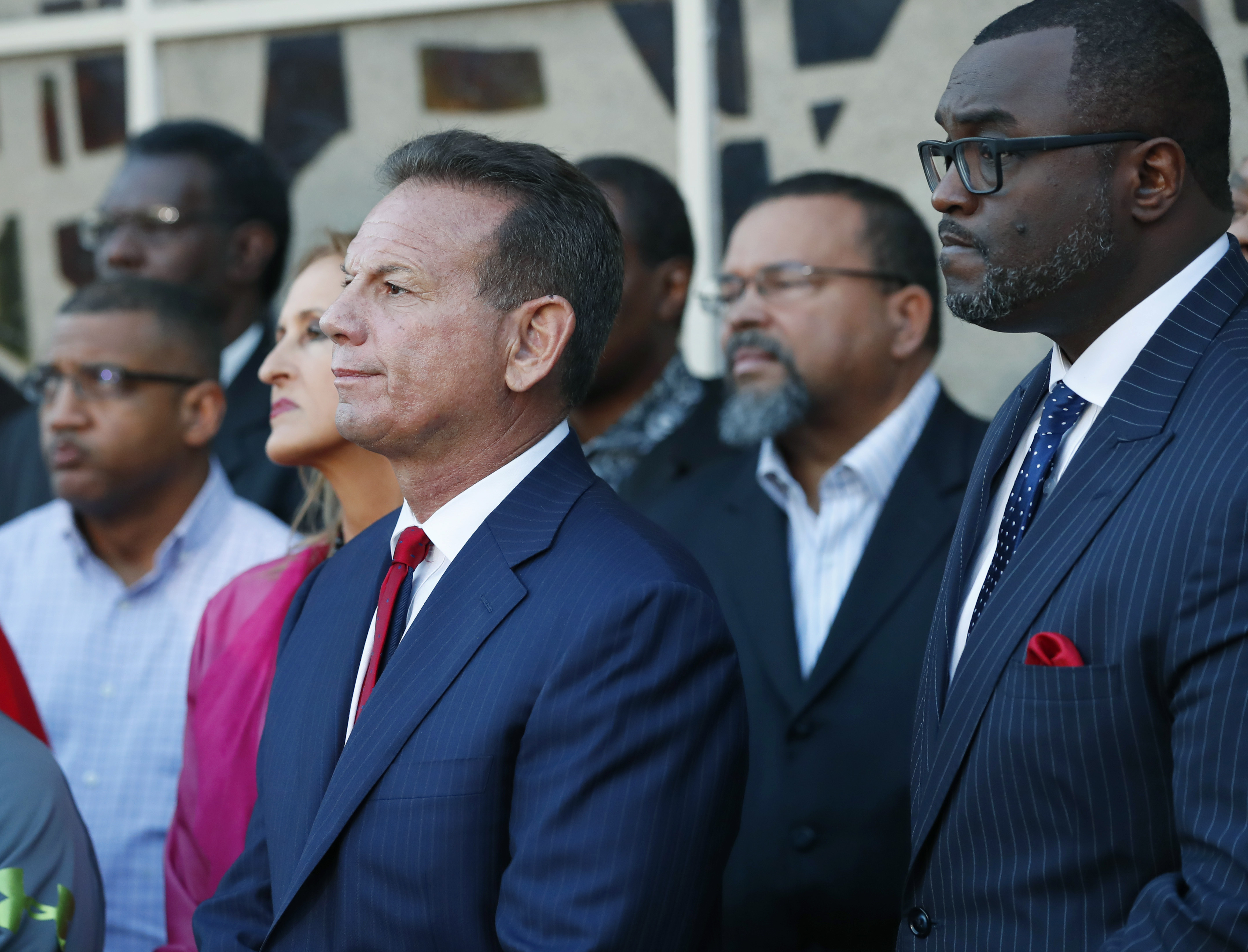 Suspended Broward County Sheriff Scott Israel (center) listens to comments by his attorney at a news conference in Fort Lauderdale, Fla., after new Florida Gov. Ron DeSantis suspended Israel on Friday, Jan. 11, 2019, over his handling of February's massacre at Marjory Stoneman Douglas High School. (Wilfredo Lee/AP)