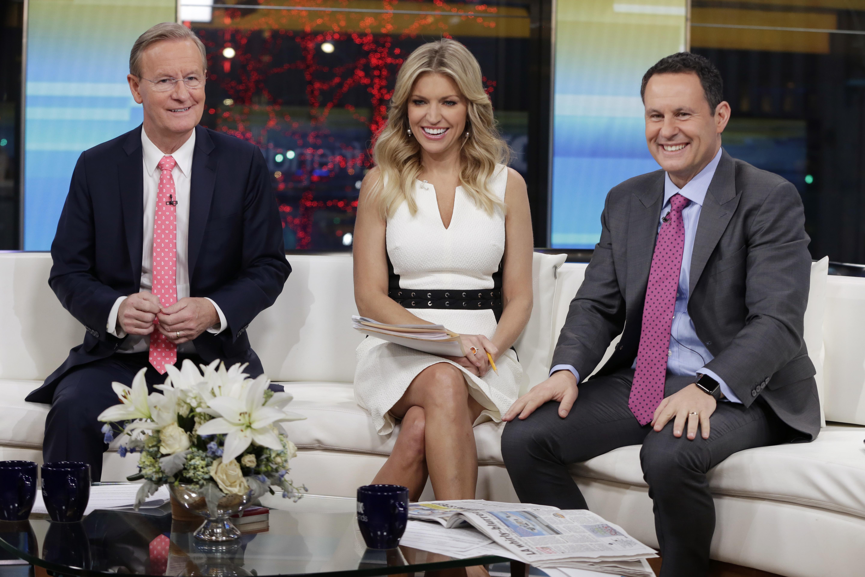 "Steve Doocy, left, Ainsley Earhardt and Brian Kilmeade, co-hosts of the ""Fox & Friends"" television program."