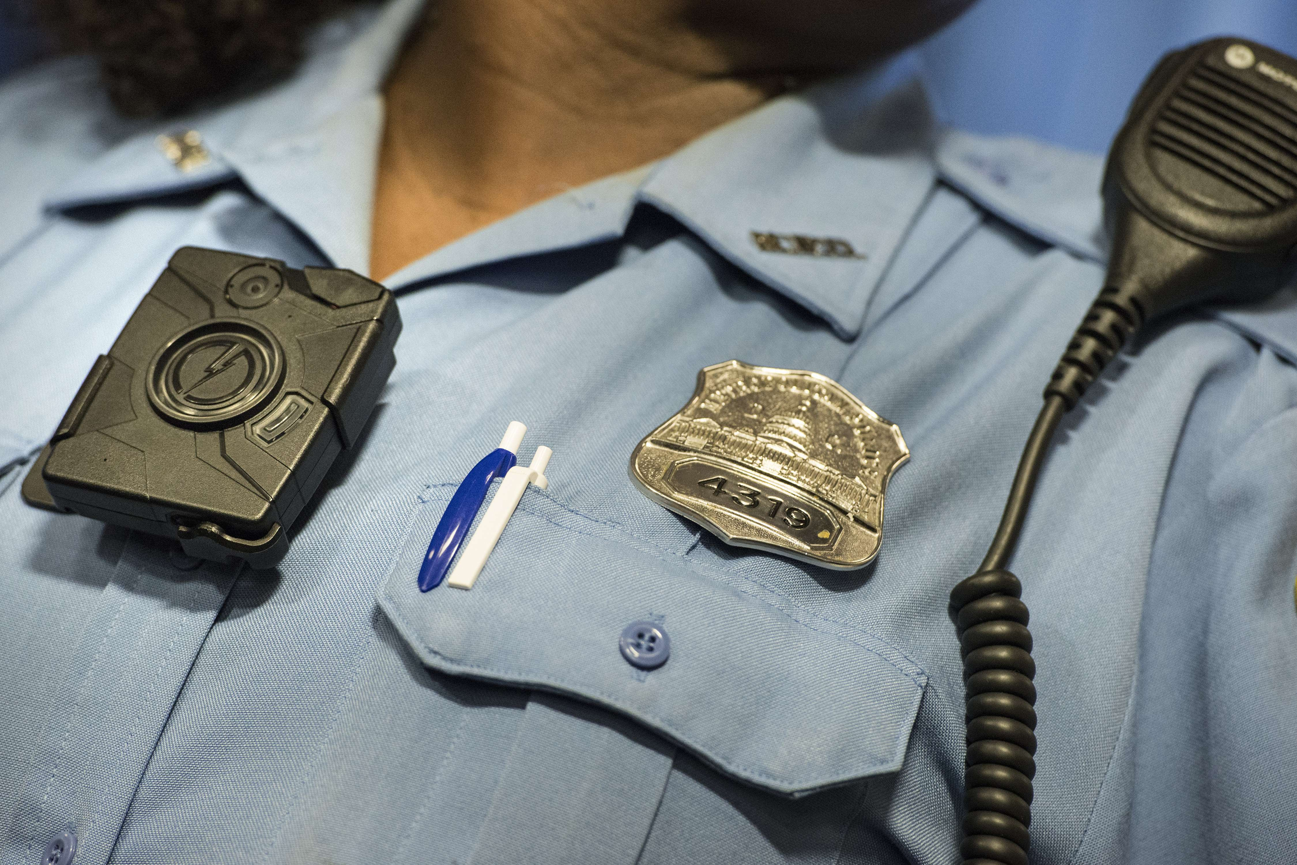 D C  police officer, another man charged with bribery in