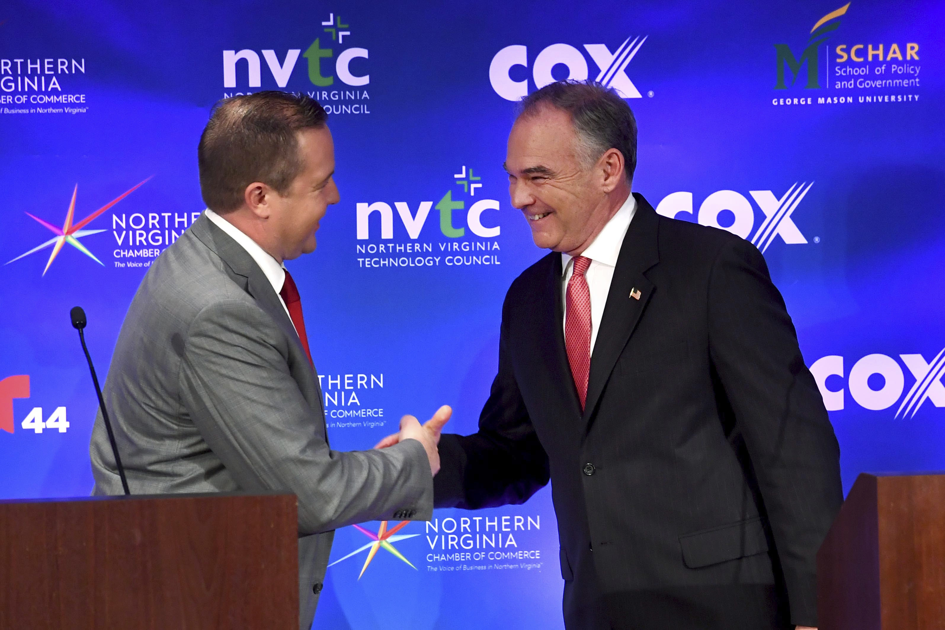 Republican Corey Stewart, left, and Sen. Tim Kaine (D-Va.) shake hands after a debate on Wednesday, Sept. 26, 2018, in Tysons. (Katherine Frey/AP)