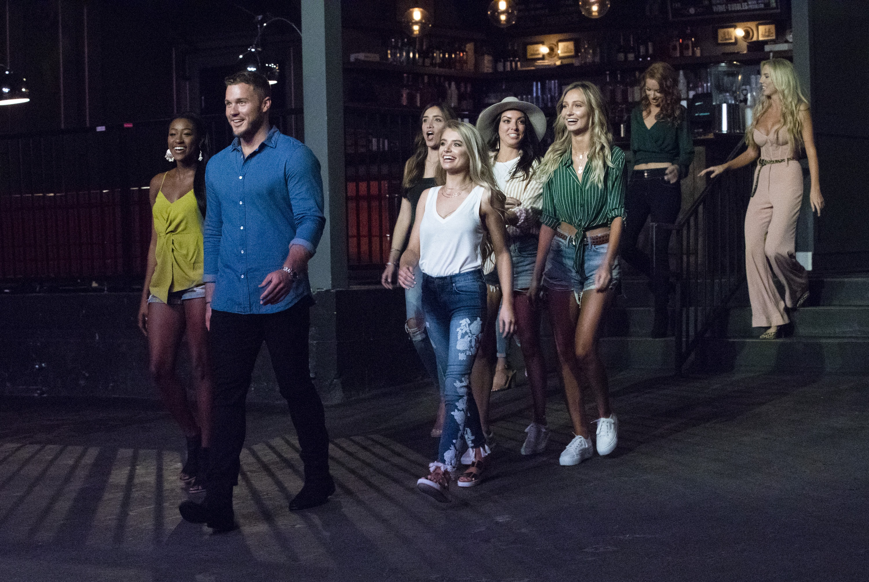 """Colton leads a group of contestants to their first group date on """"The Bachelor."""" (Rick Rowell/ABC)"""